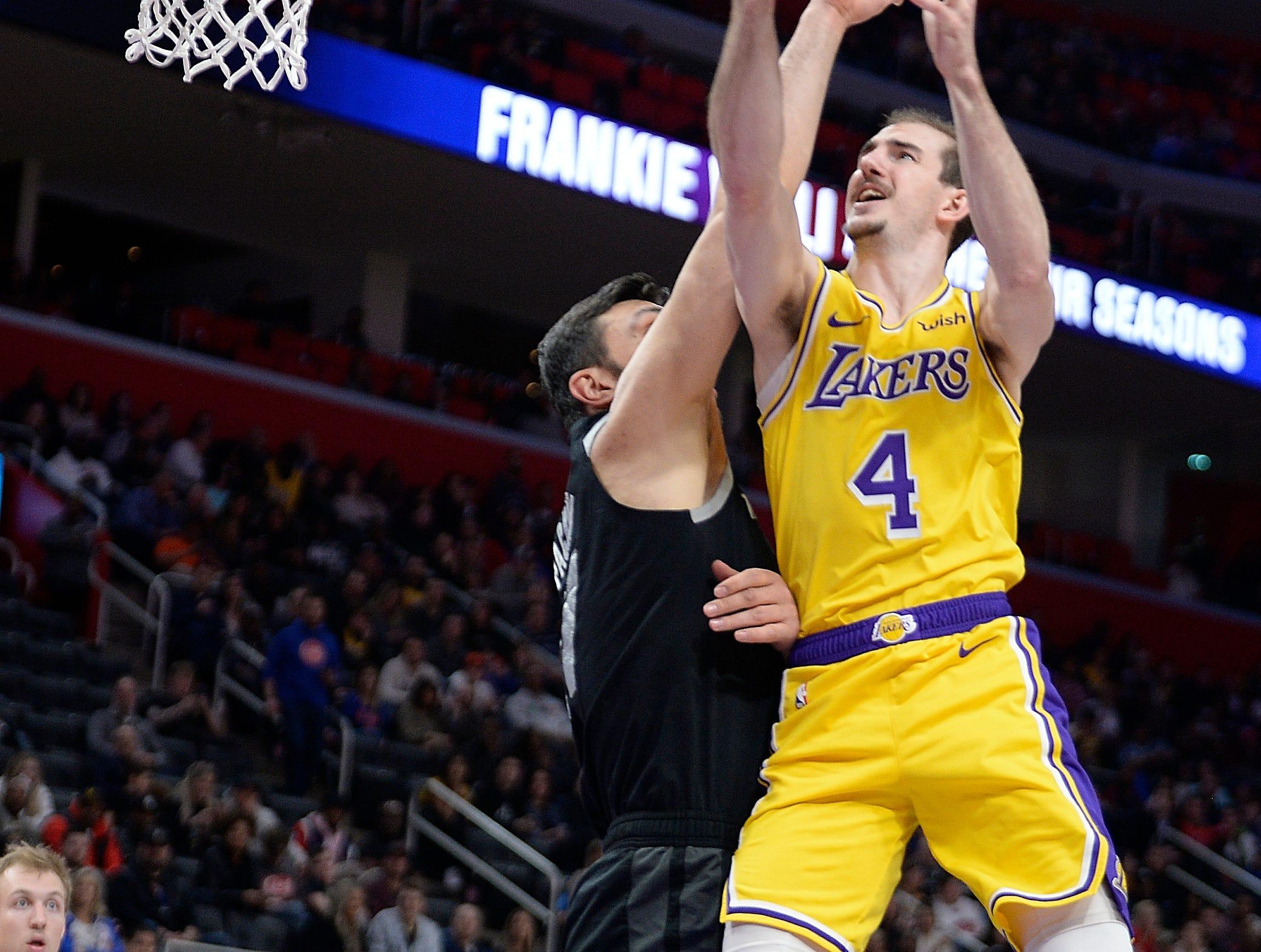 Lakers' Alex Caruso scores over Pistons' ZaZa Pachulia in the fourth quarter.