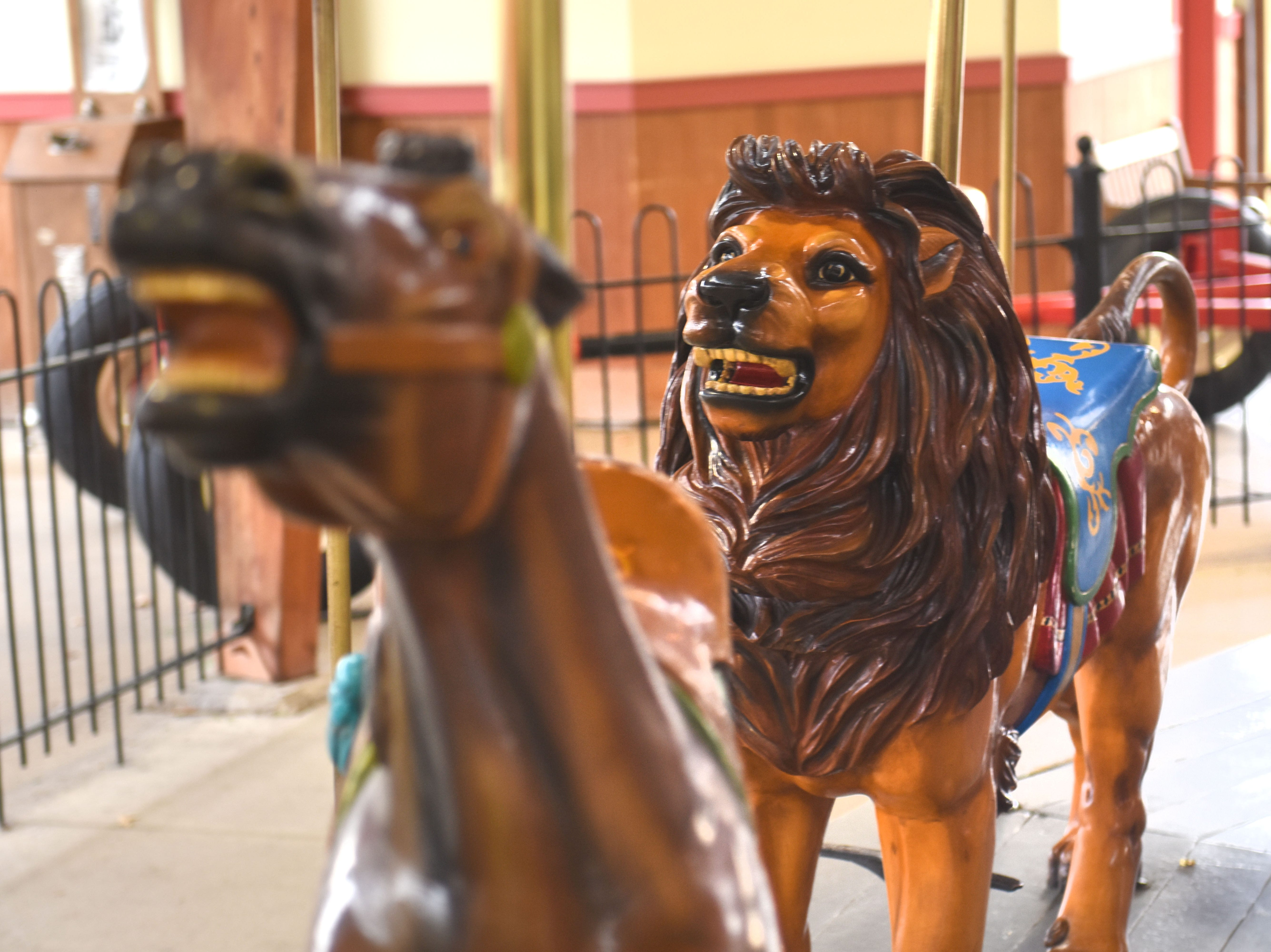 The grand lion seems to be chasing fellow carousel figures at Greenfield Village in Dearborn