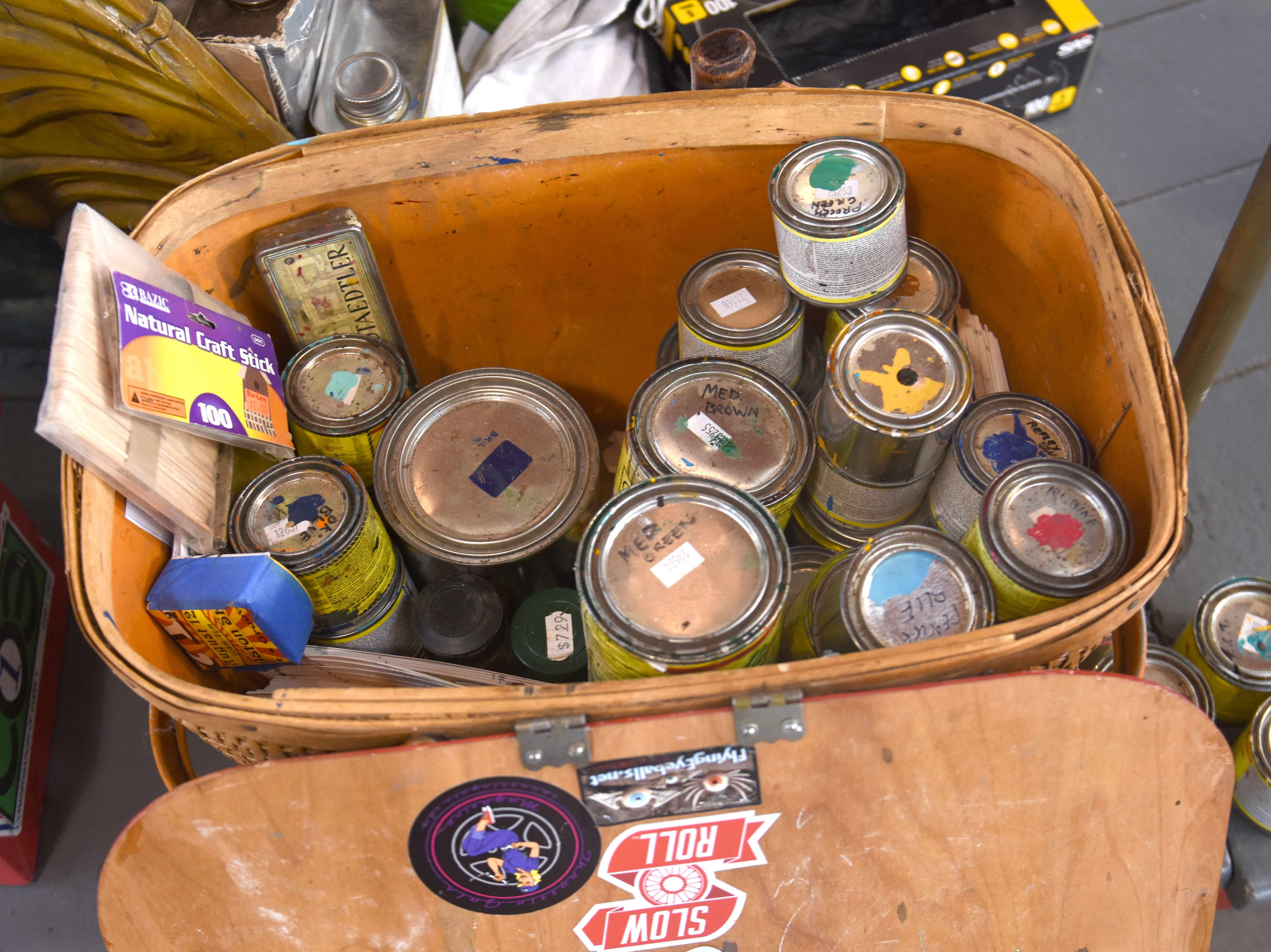 Small paint cans are part of Julie Fournier's palette of colors.