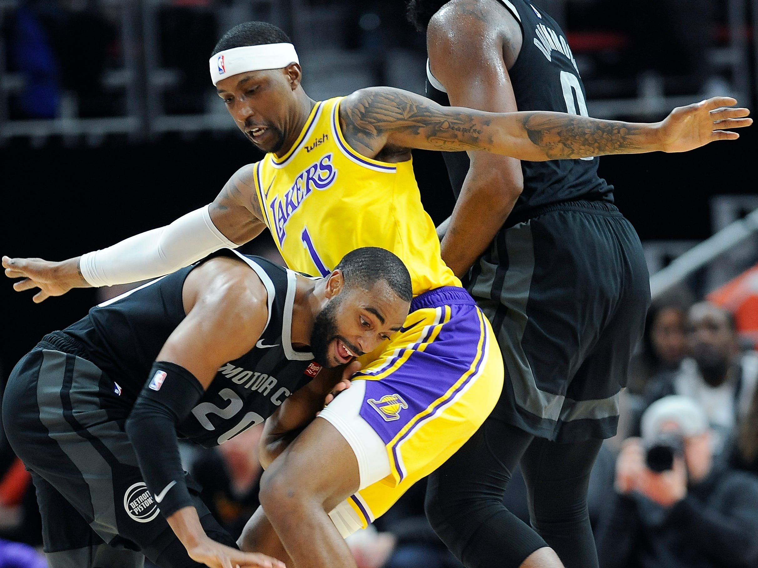 Pistons' Wayne Ellington drives around Lakers' Kentavious Caldwell-Pope in the third quarter. The Pistons defeated the Lakers 111-97, Friday, March 15, 2019 at Little Caesars Arena in Detroit, Michigan.