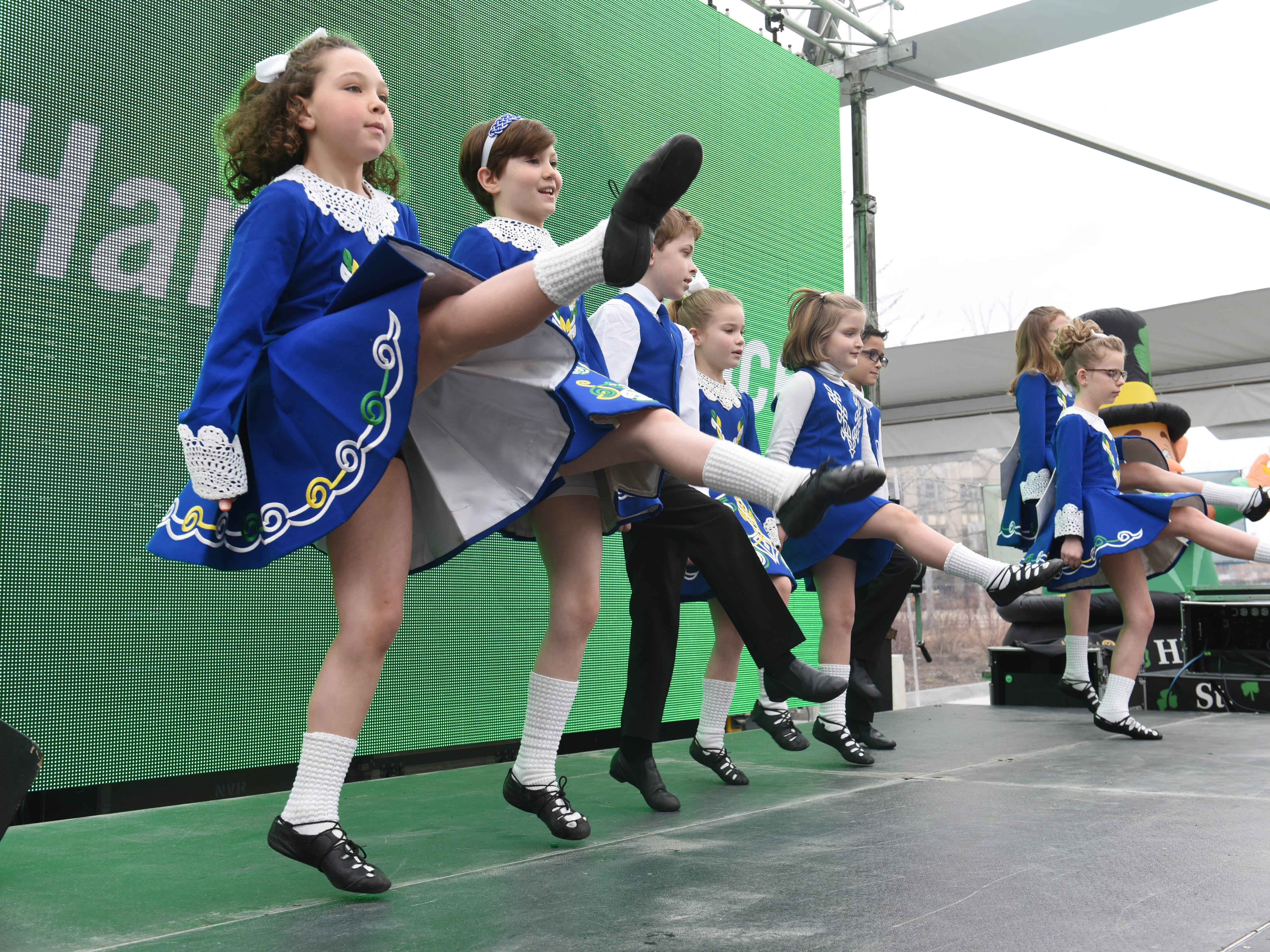 Members of the Tim O'Hare Irish Dance group of Ann Arbor/Plymouth perform on stage during the St. Patrick's Day Party at Beacon Park on Saturday, March 16, 2019.