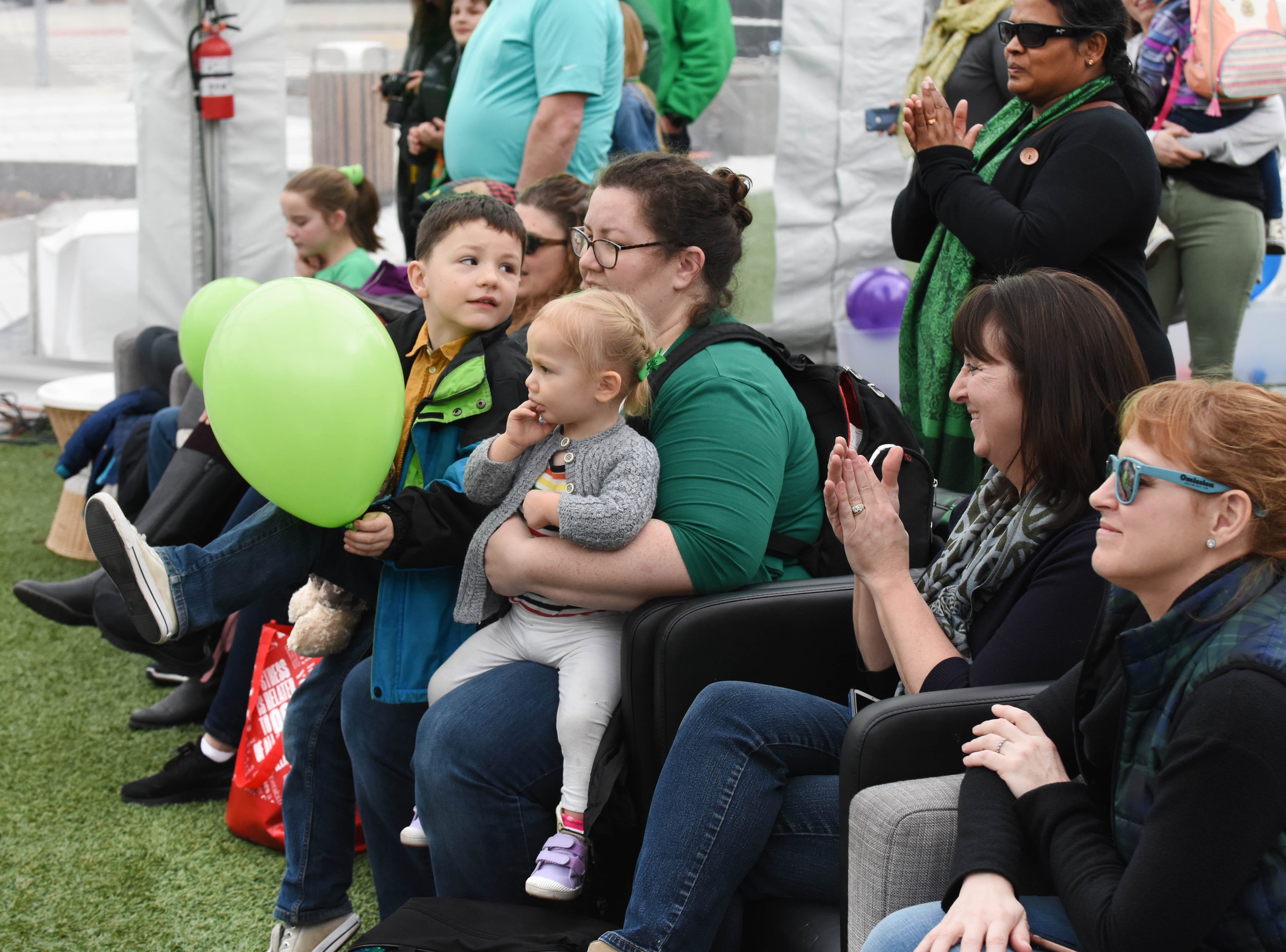 Family and friends watch the Tim O'Hare Irish Dance group.