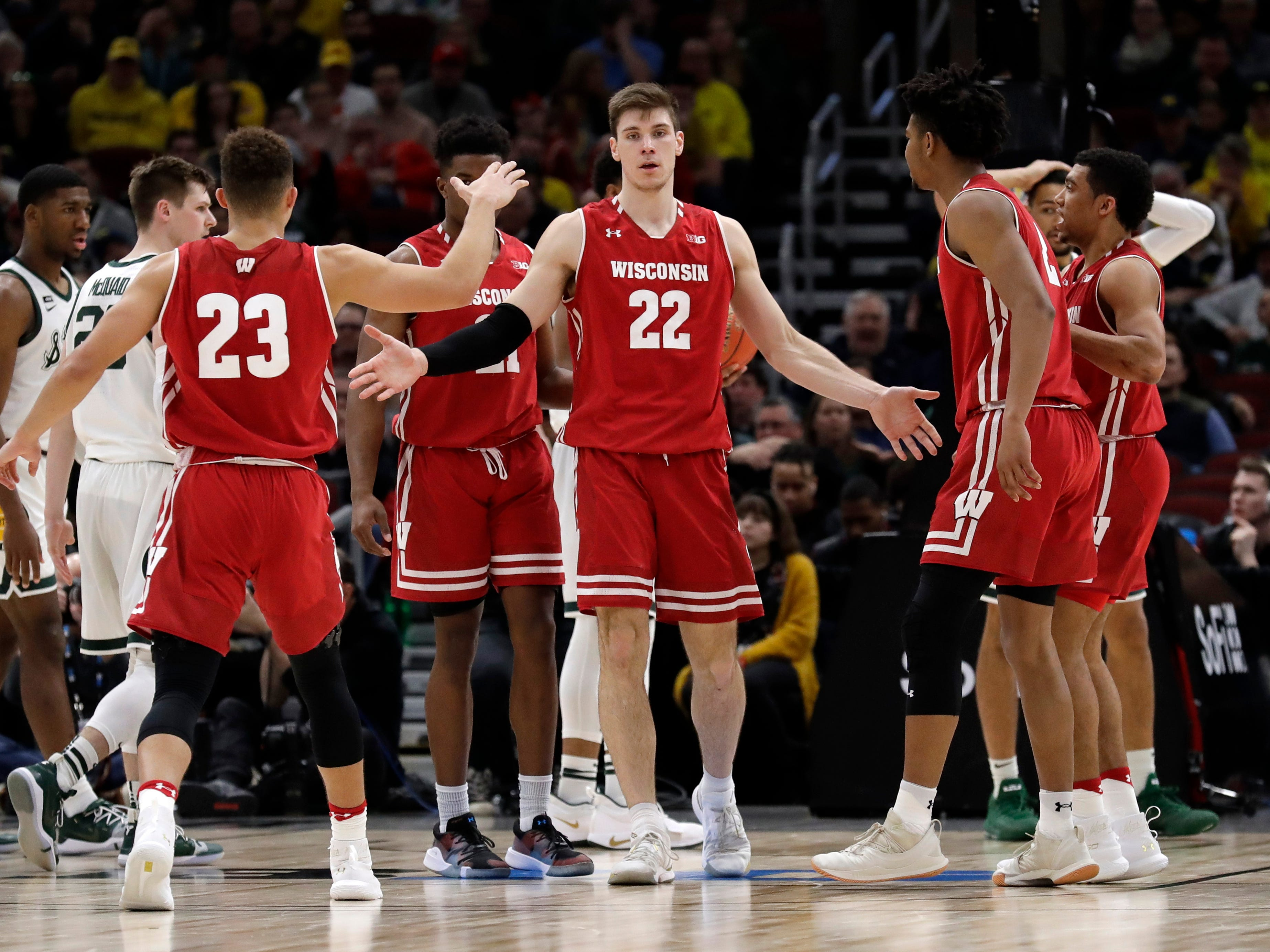 Wisconsin's Ethan Happ celebrates with his teammates after getting fouled during the second half.