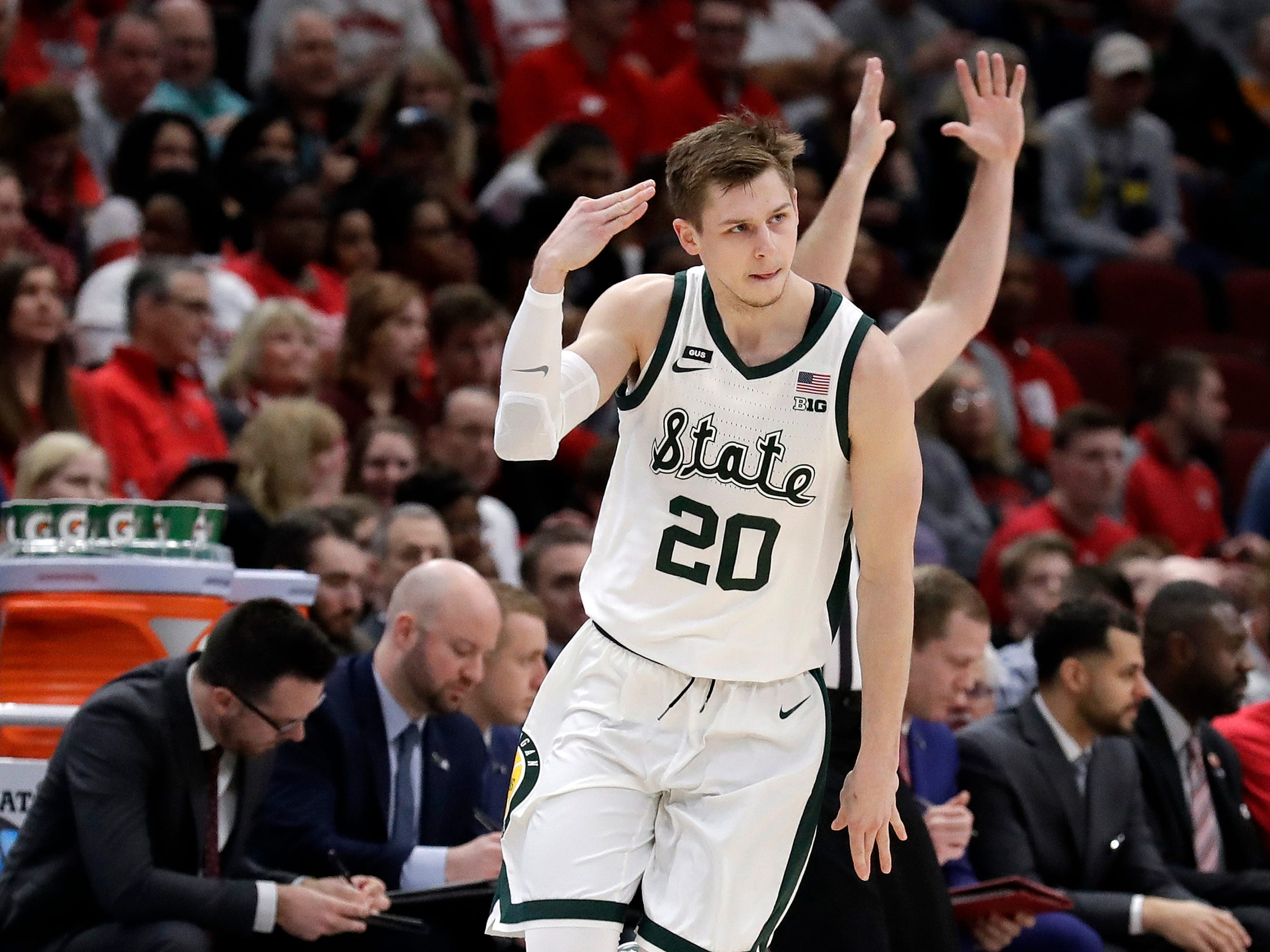 Michigan State's Matt McQuaid reacts after shooting a 3-point basket during the first half.
