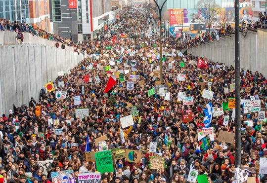 Students hold a demonstration to protest against climate change, Friday, March 15, 2019 in Montreal.
