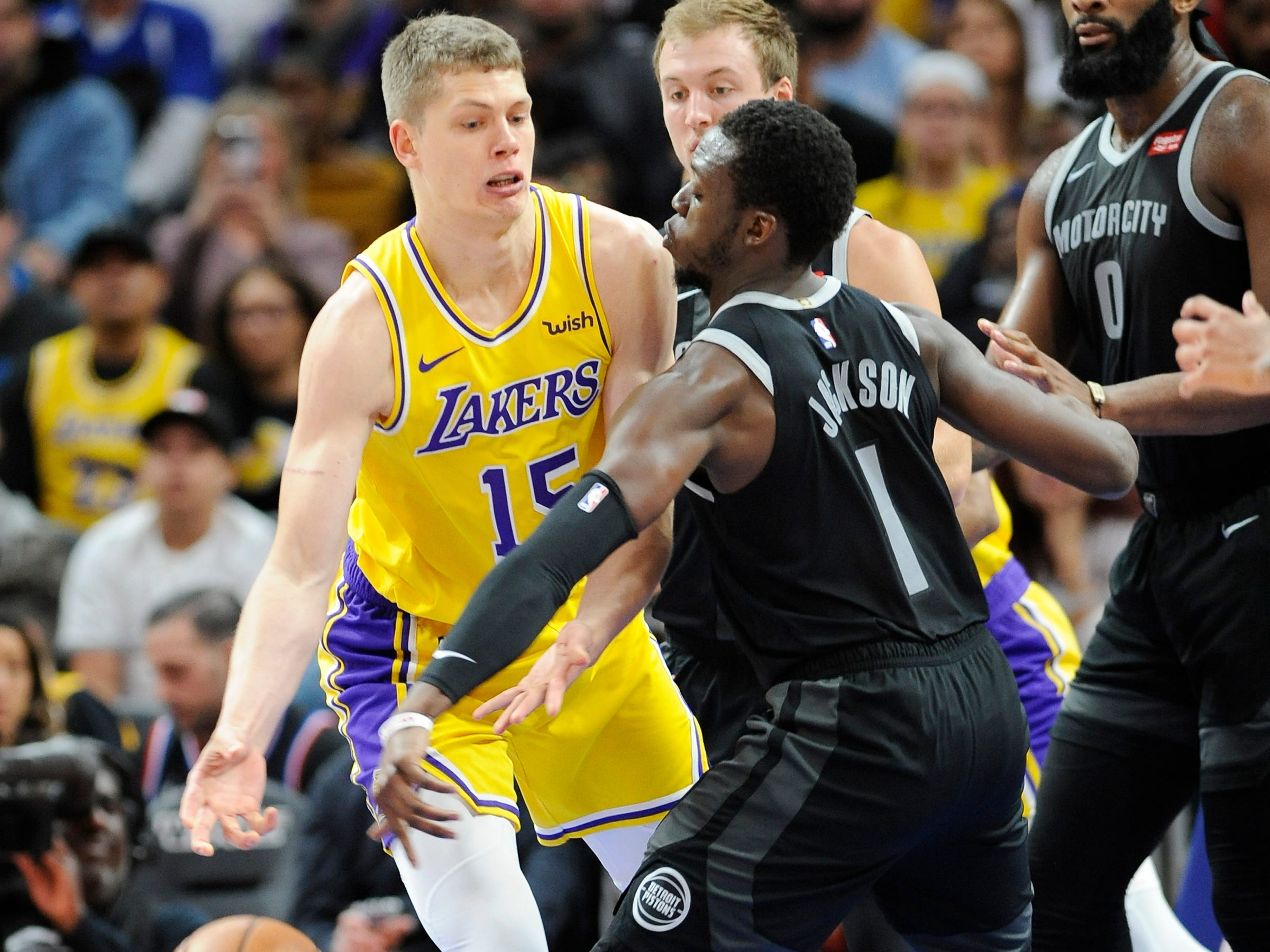 Pistons' Reggie Jackson steals the ball from Lakers' Moritz Wagner in the second quarter.