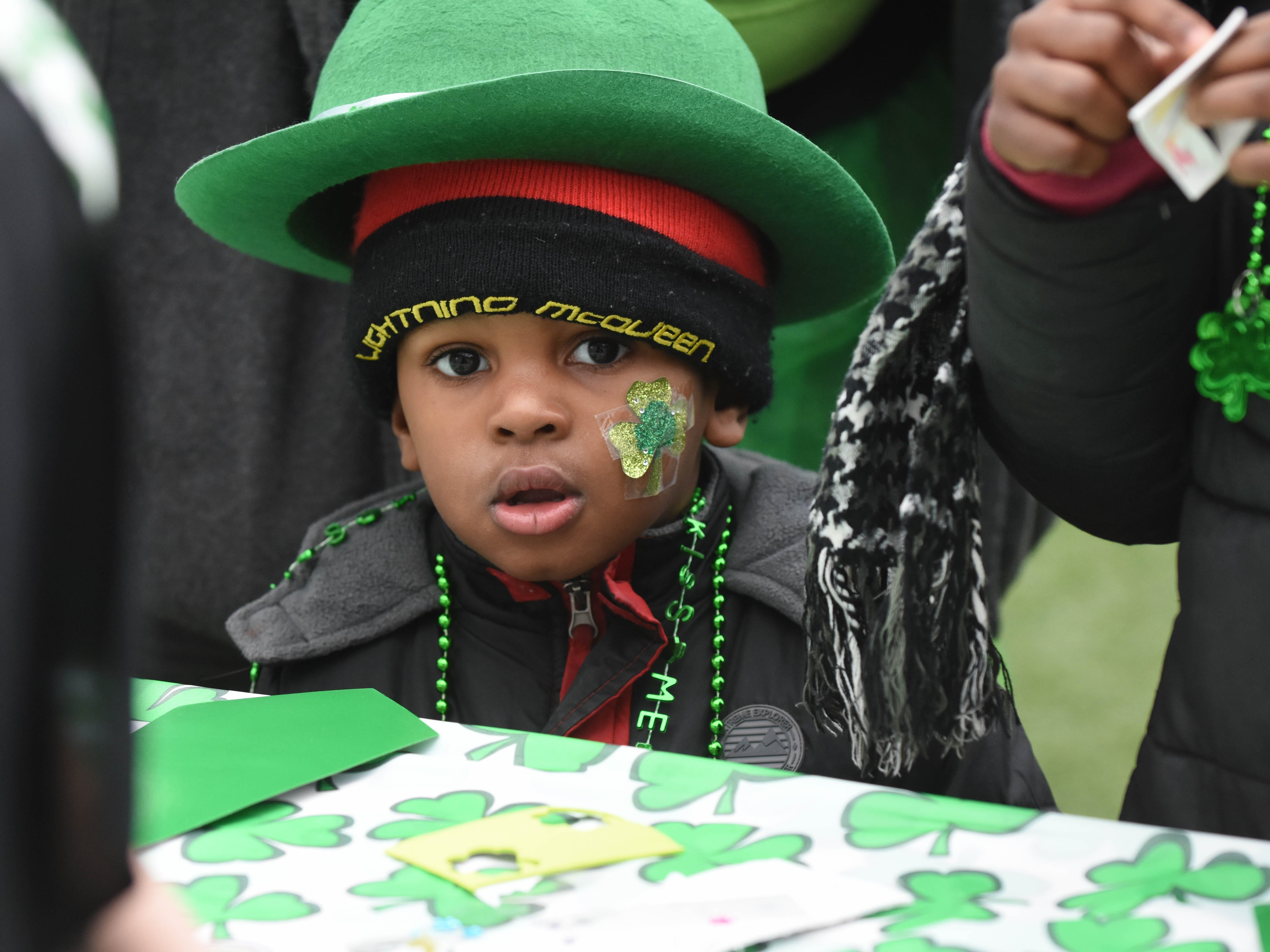 LJ Rhodes dons a green hat and necklace during the St. Patrick's Day Party at Beacon Park.