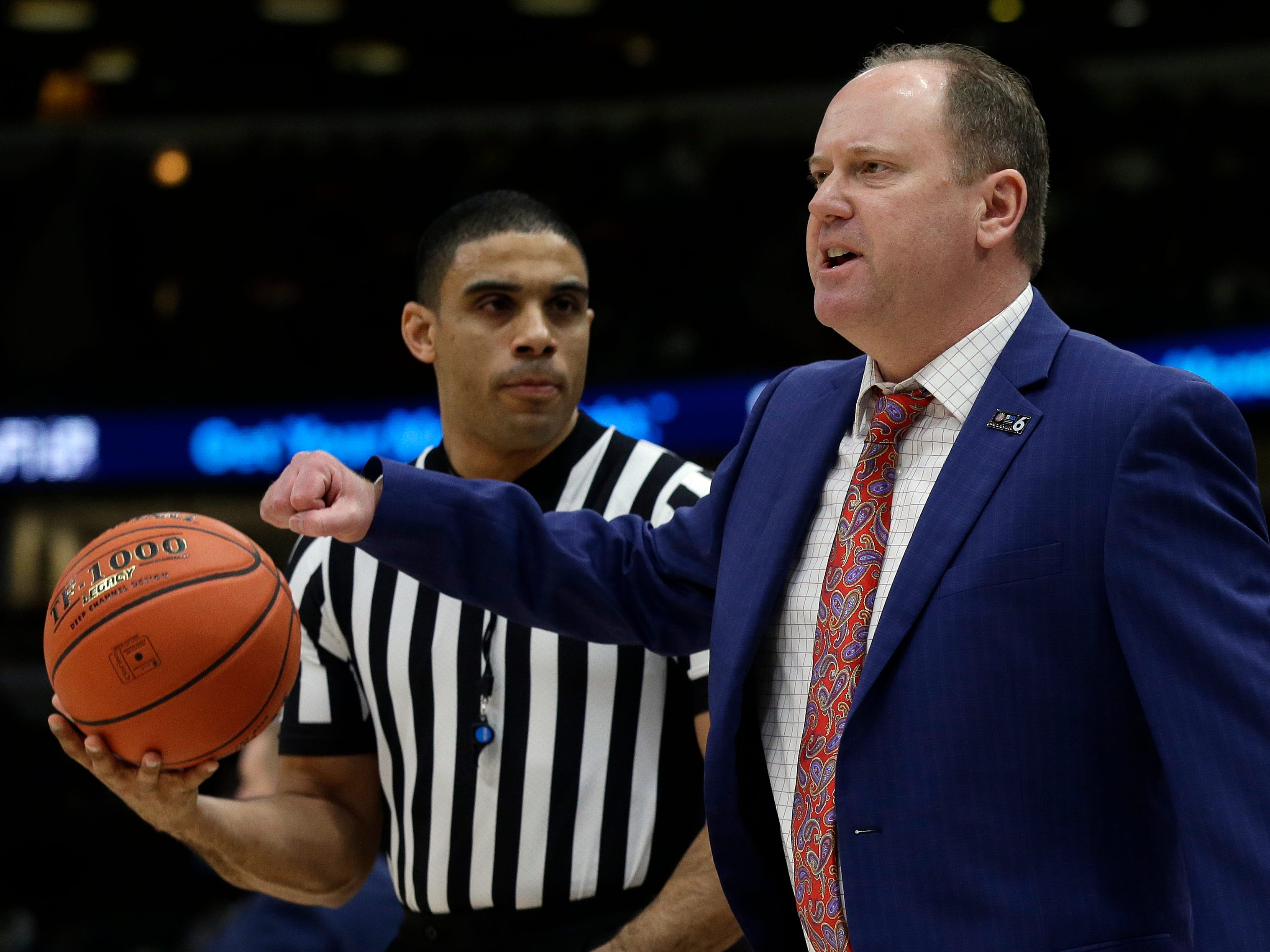 Wisconsin head coach Greg Gard argues a call during the first half.