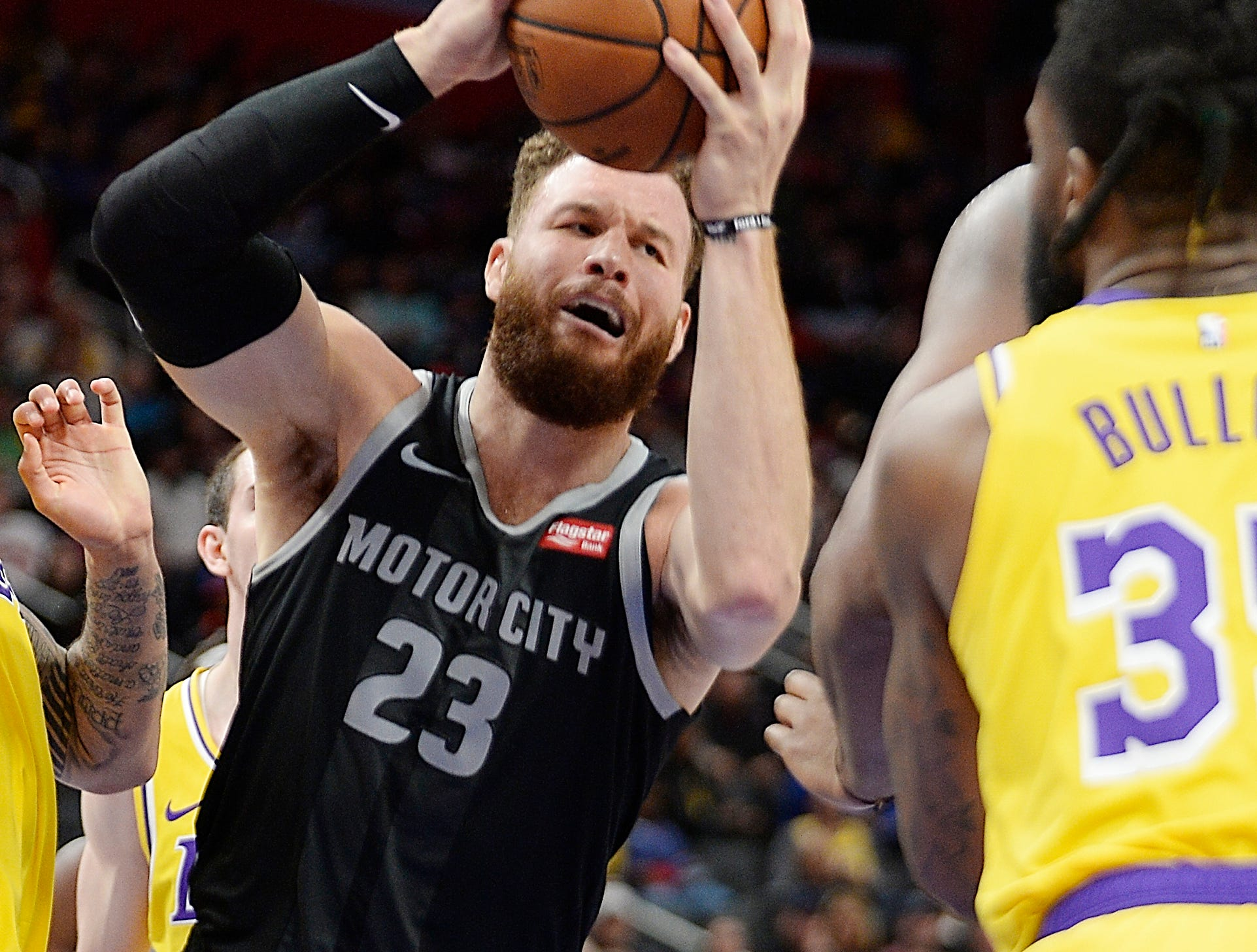Pistons' Blake Griffin grabs a rebound in front of Lakers' Reggie Bullock in the second quarter.