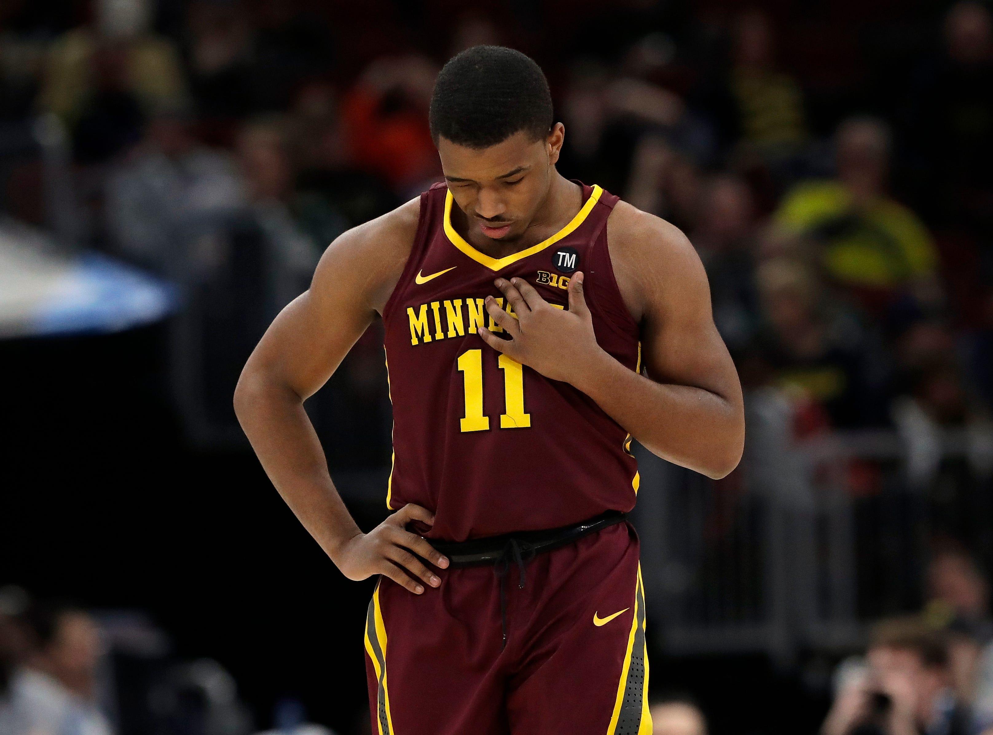 Minnesota's Isaiah Washington looks down during the second half.