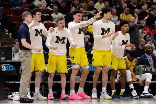 Michigan bench reacts during the first half against Iowa.