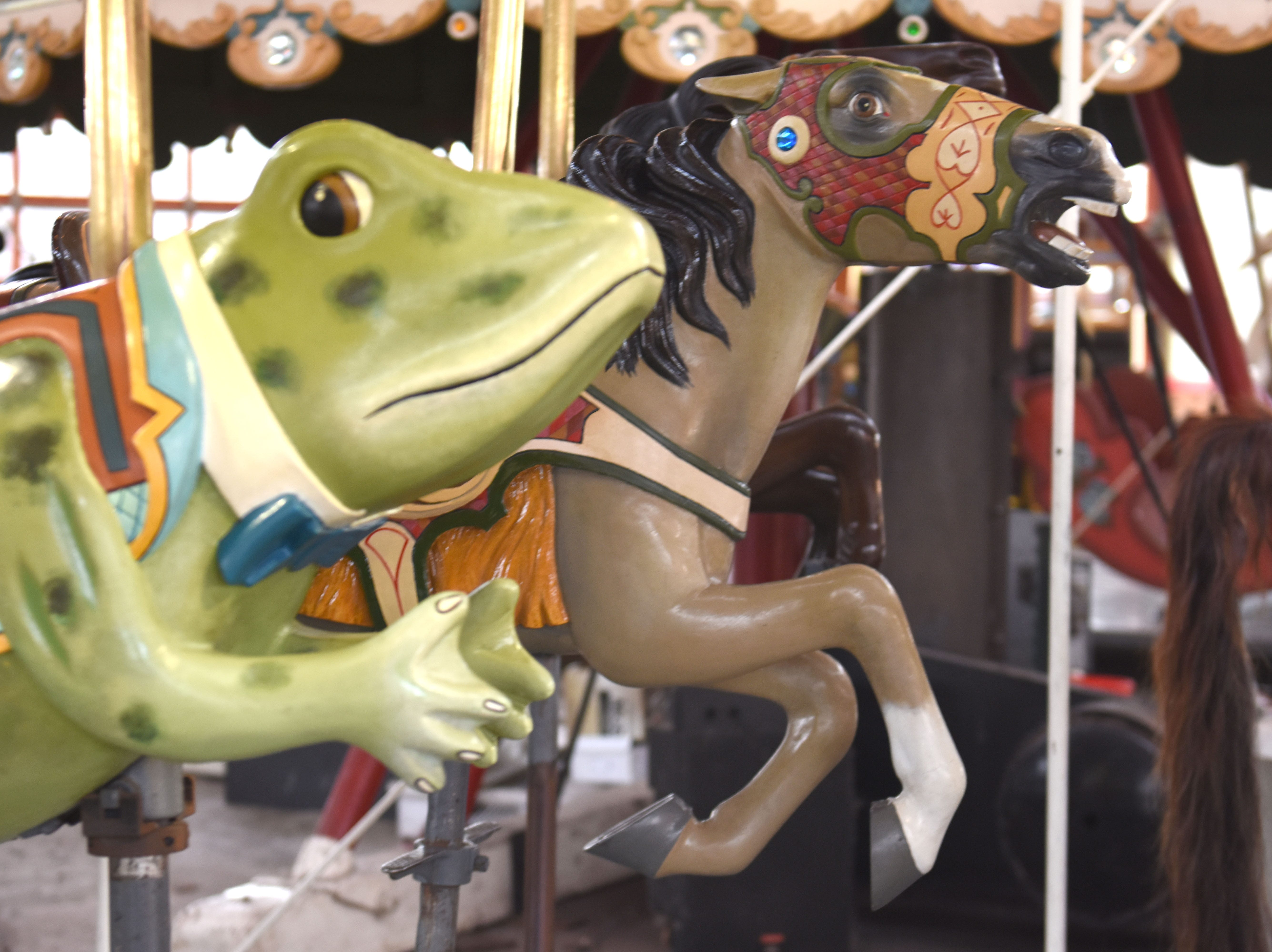 A horse and frog are two of the many carousel figures at Greenfield Village.