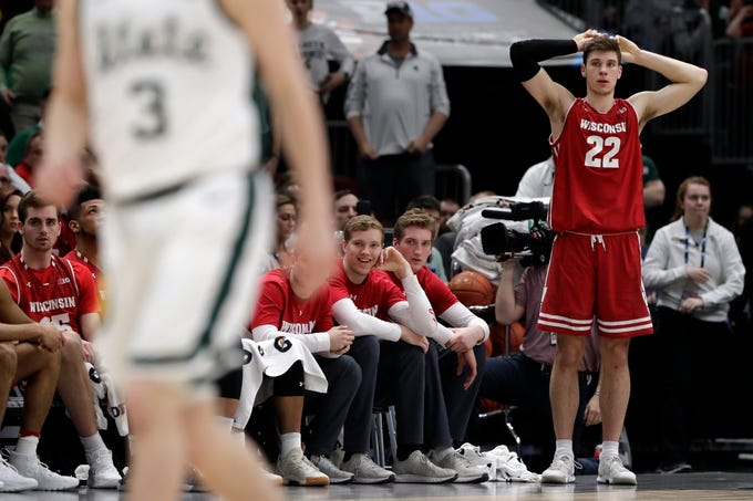 Wisconsin's Ethan Happ reacts as players watch from the bench during the second half the Big Ten semifinal against Michigan State on Saturday March 16, 2019, at United Center in Chicago. Michigan State won, 67-55.