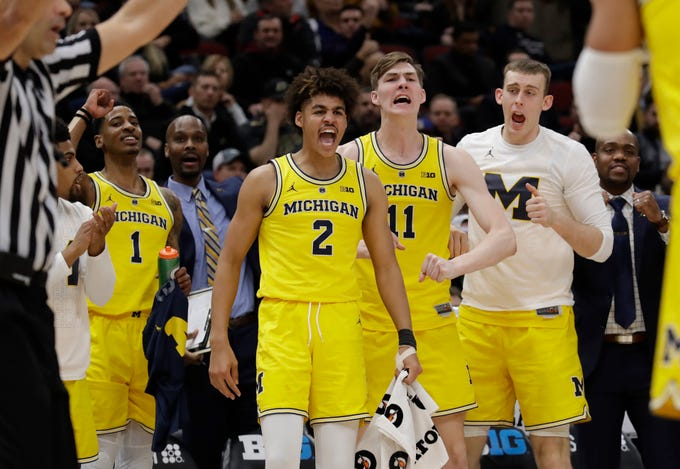 Michigan bench react to a play during the first half of their Big Ten Tournament quarterfinals game against Iowa on Friday, March 15, 2019, in Chicago.