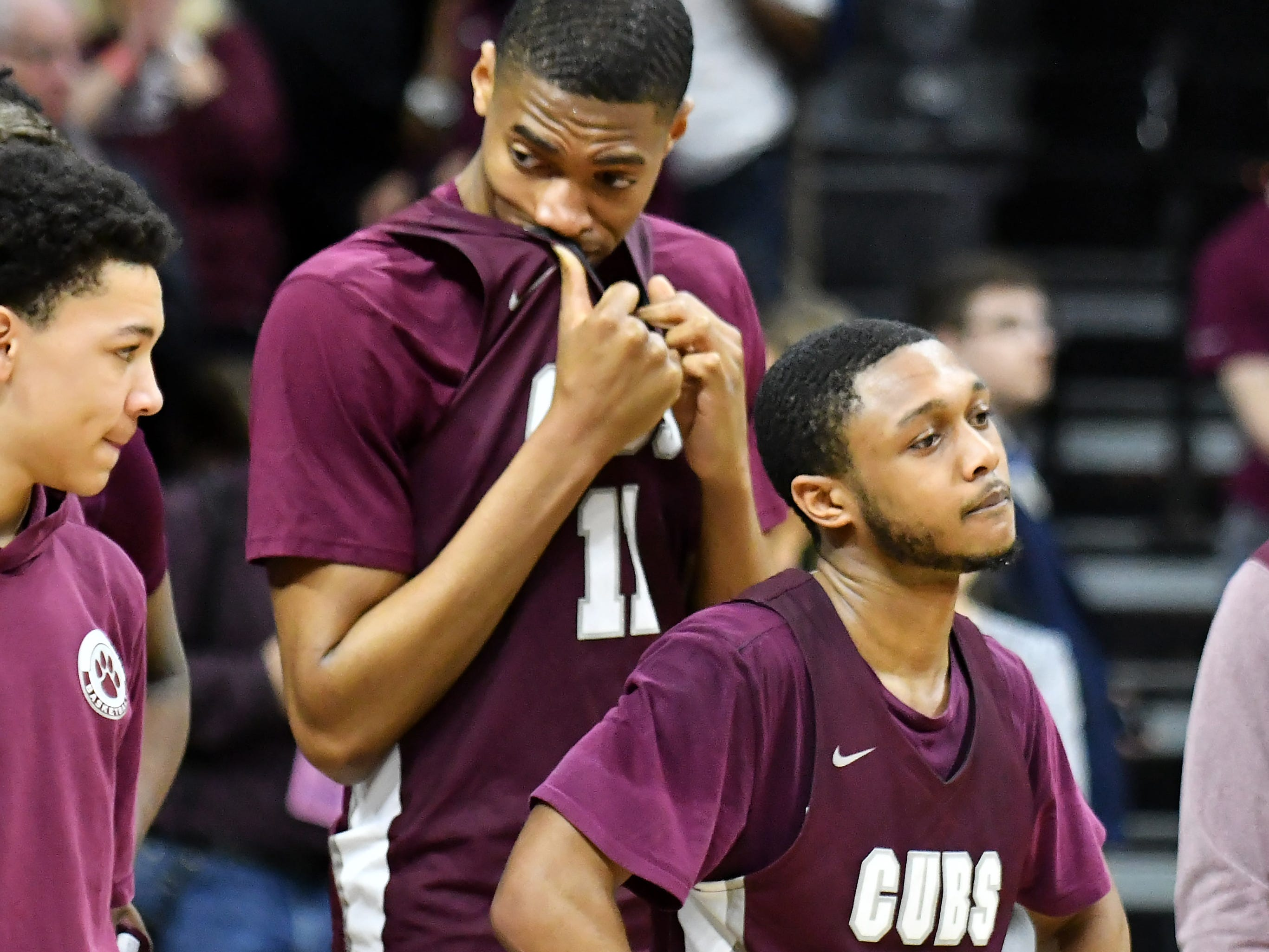 U-D Jesuit's Jalen Thomas (11) and Jordan Montgomery about to receive the runner-up trophy after the game.