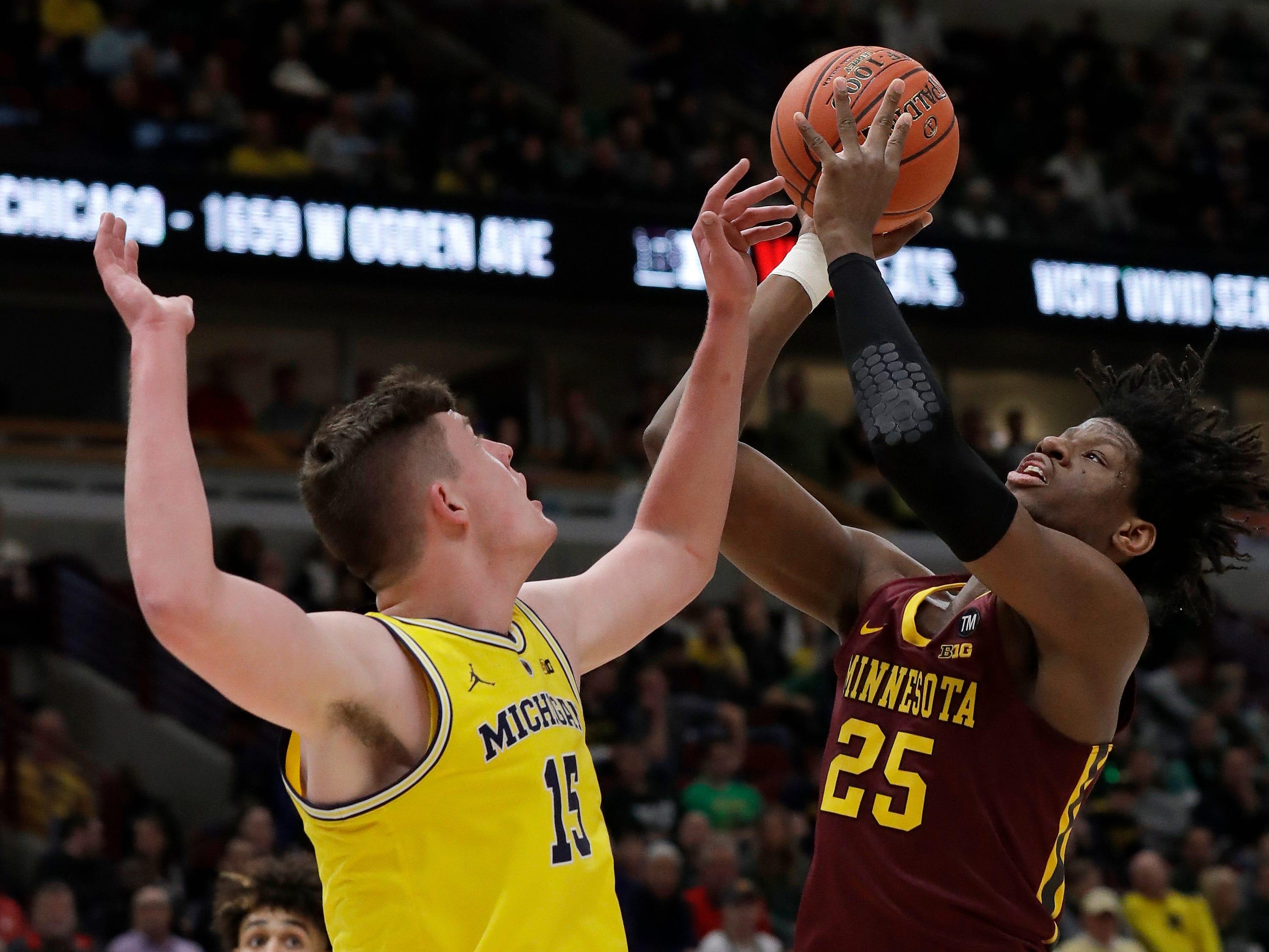 Michigan's Jon Teske blocks a shot by Minnesota's Daniel Oturu during the first half of the semifinals of the Big Ten tournament.