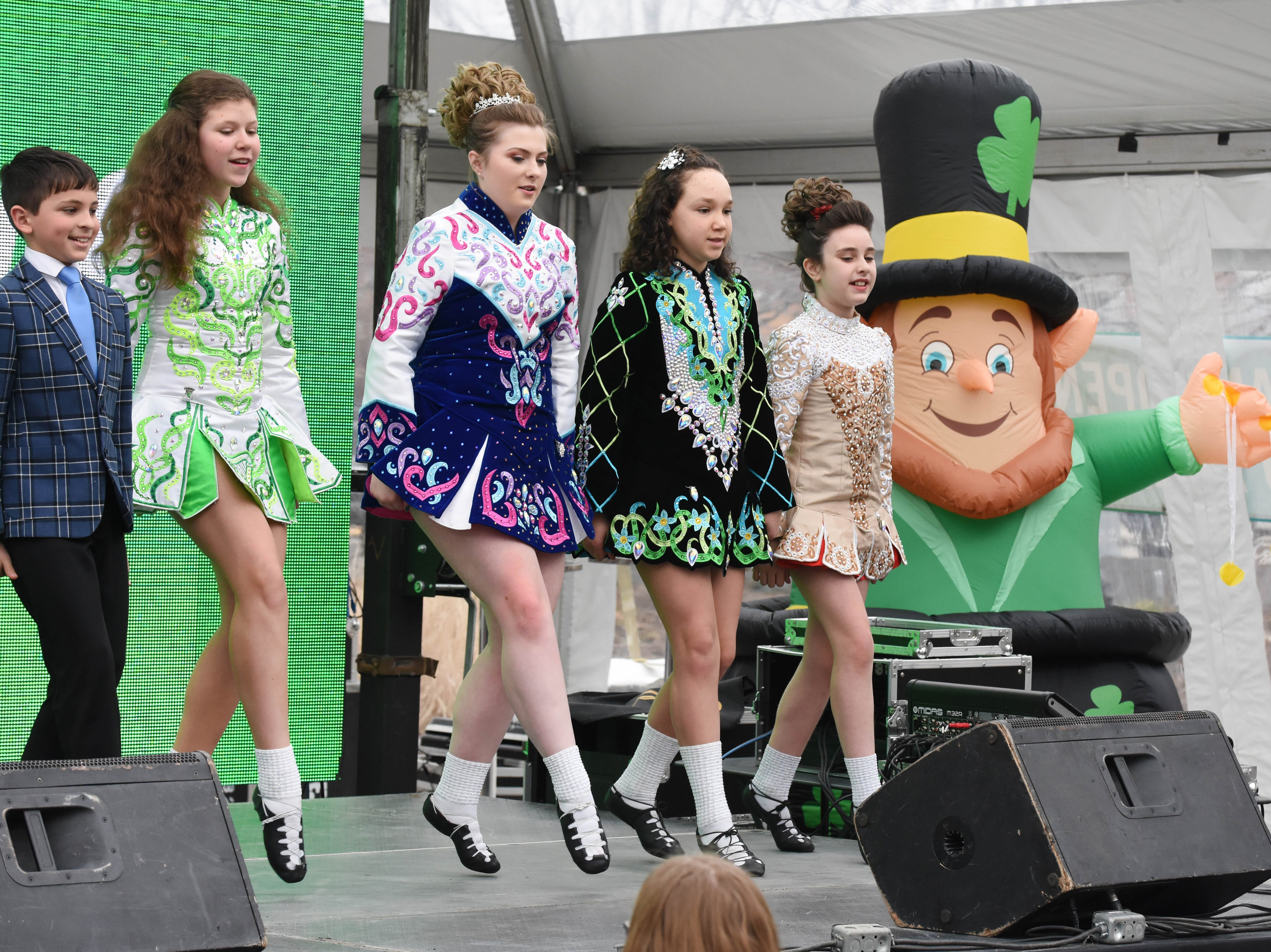 Members of the Tim O'Hare Irish Dance group of Ann Arbor/Plymouth perform on stage.