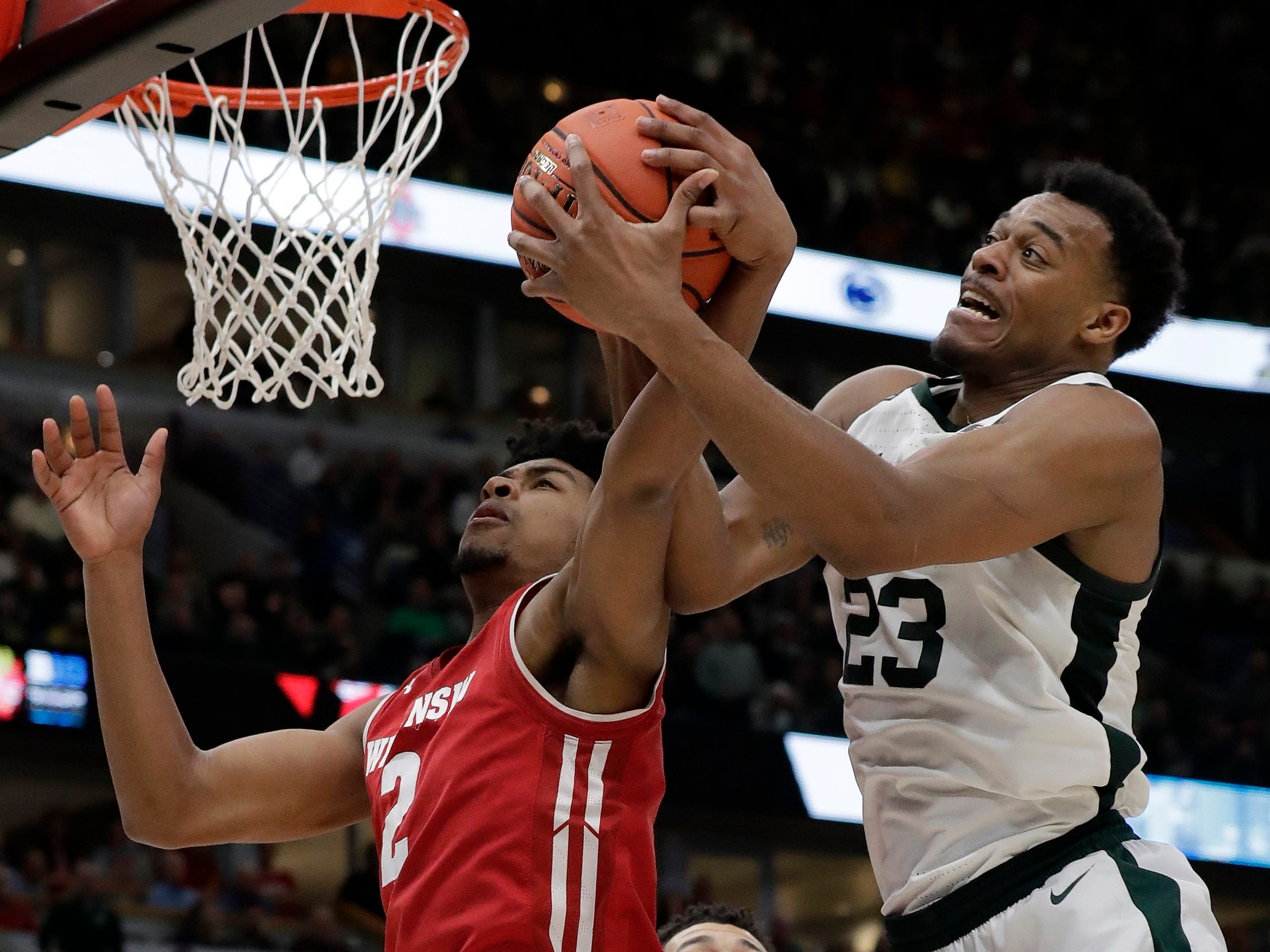 Wisconsin's Aleem Ford and Michigan State's Xavier Tillman battle for a rebound during the second half.