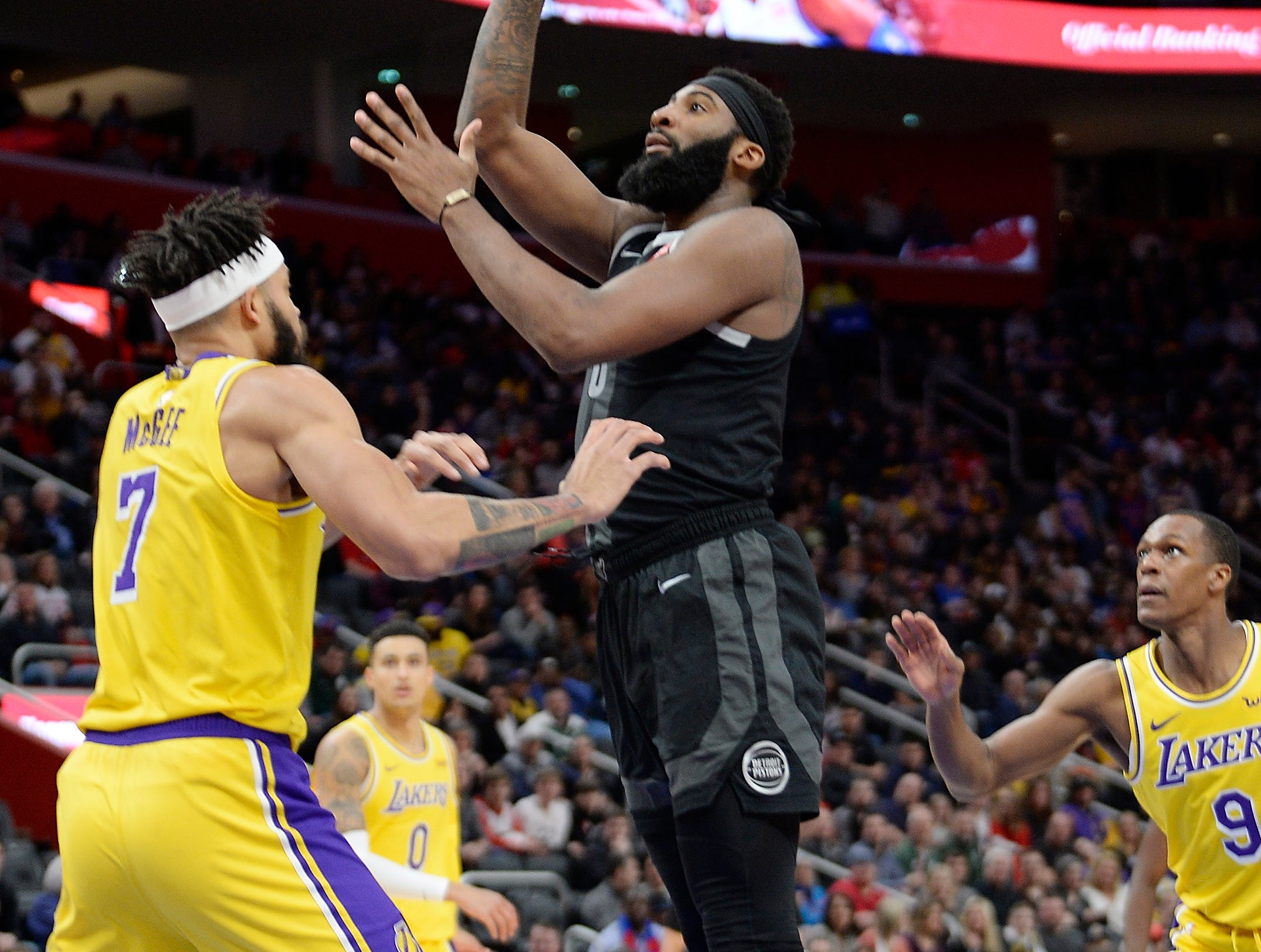 Pistons' Andre Drummond shoots over Lakers' JaVale McGee in the first quarter.