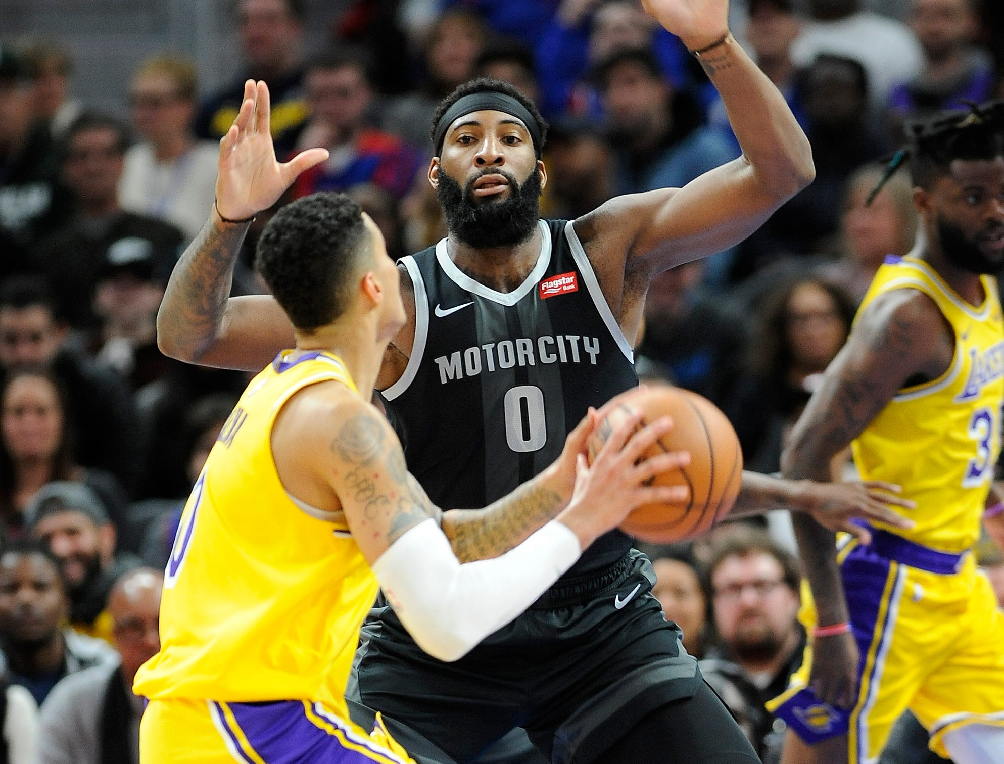 Pistons' Andre Drummond defends Lakers' Kyle Kuzman in the second quarter.