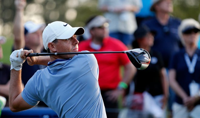 Rory McIlroy hits his tee shot on the 18th hole.