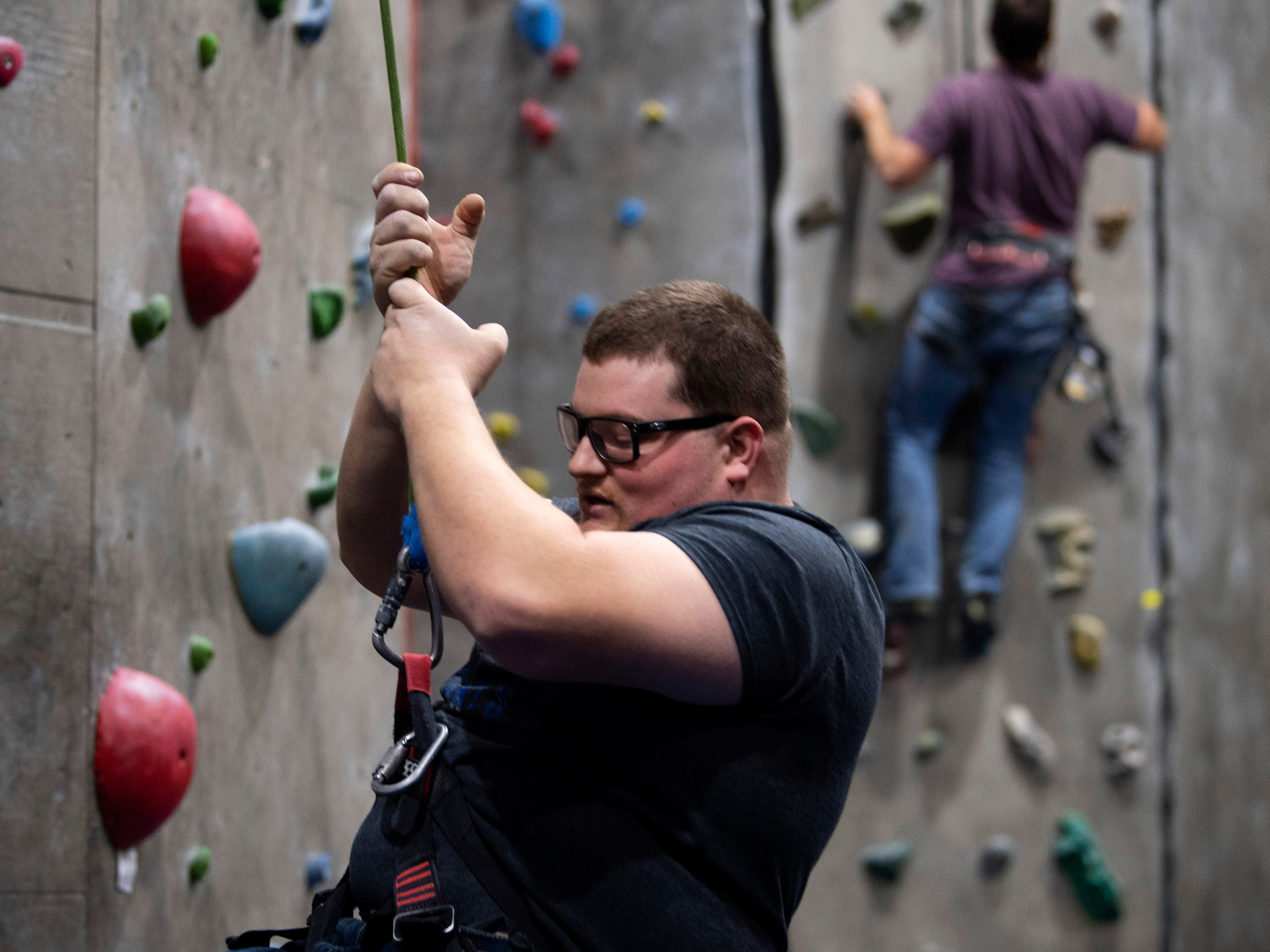 Bradley West of Morganfield, Ky., descends from the auto-belay climbing wall at Vertical eXcape at 1315 N. Royal Avenue in Evansville Friday evening.
