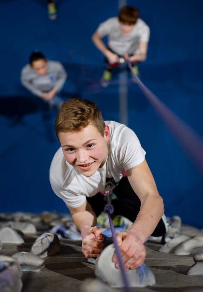 Brennan Carter, 16, of Evansville makes his first-ever climb during his orientation at Vertical eXcape at 1315 N. Royal Avenue in Evansville Friday evening. The business celebrated its 20th year of operation in February and has since branched out to open another facility in Bowling Green, Ky.
