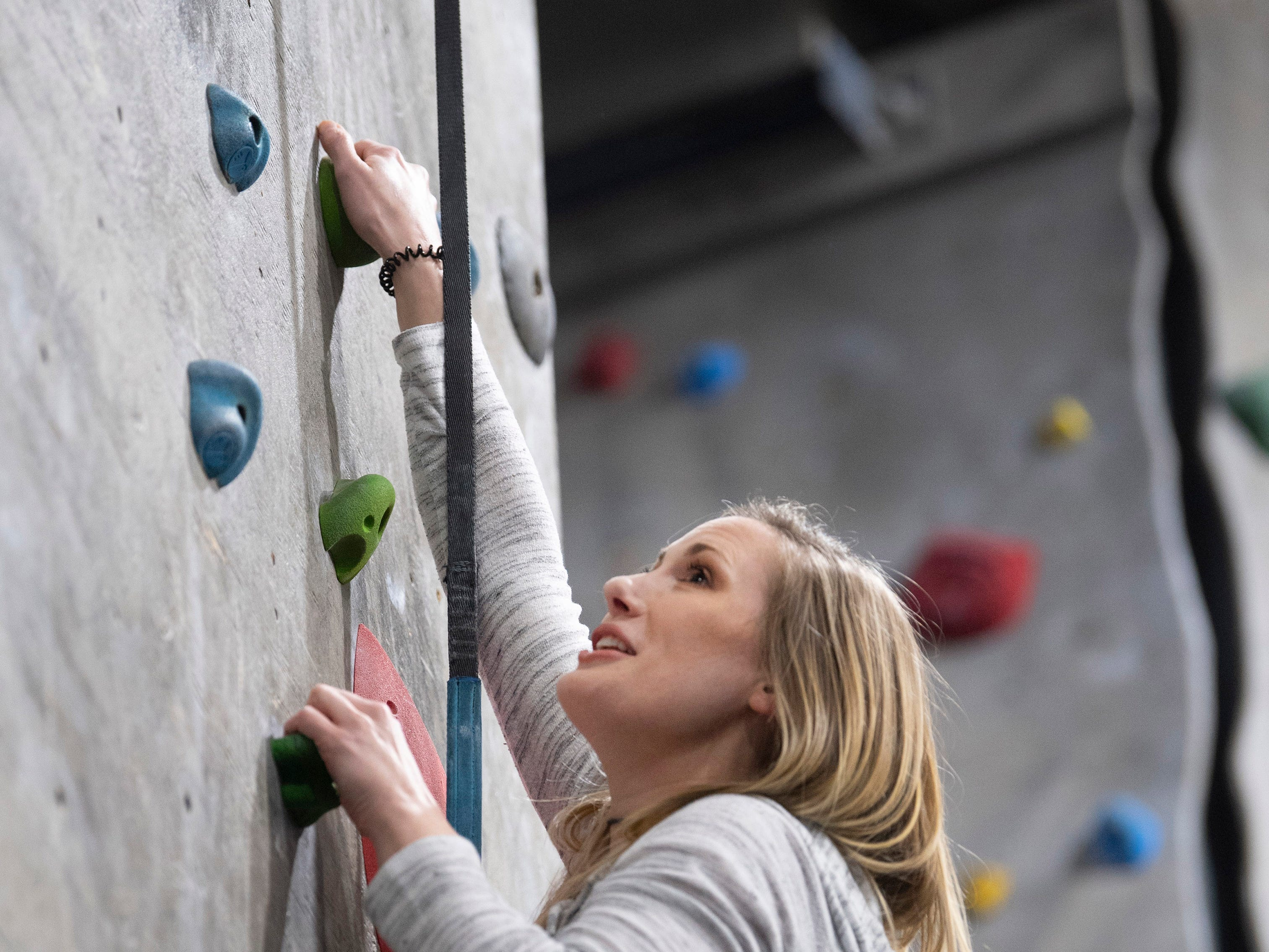 Heather Fuller of Henderson, Ky., races up an auto-belay course in hopes of beating her friend, Bradley West of Morganfield, Ky., at Vertical eXcape at 1315 N. Royal Avenue in Evansville Friday evening.