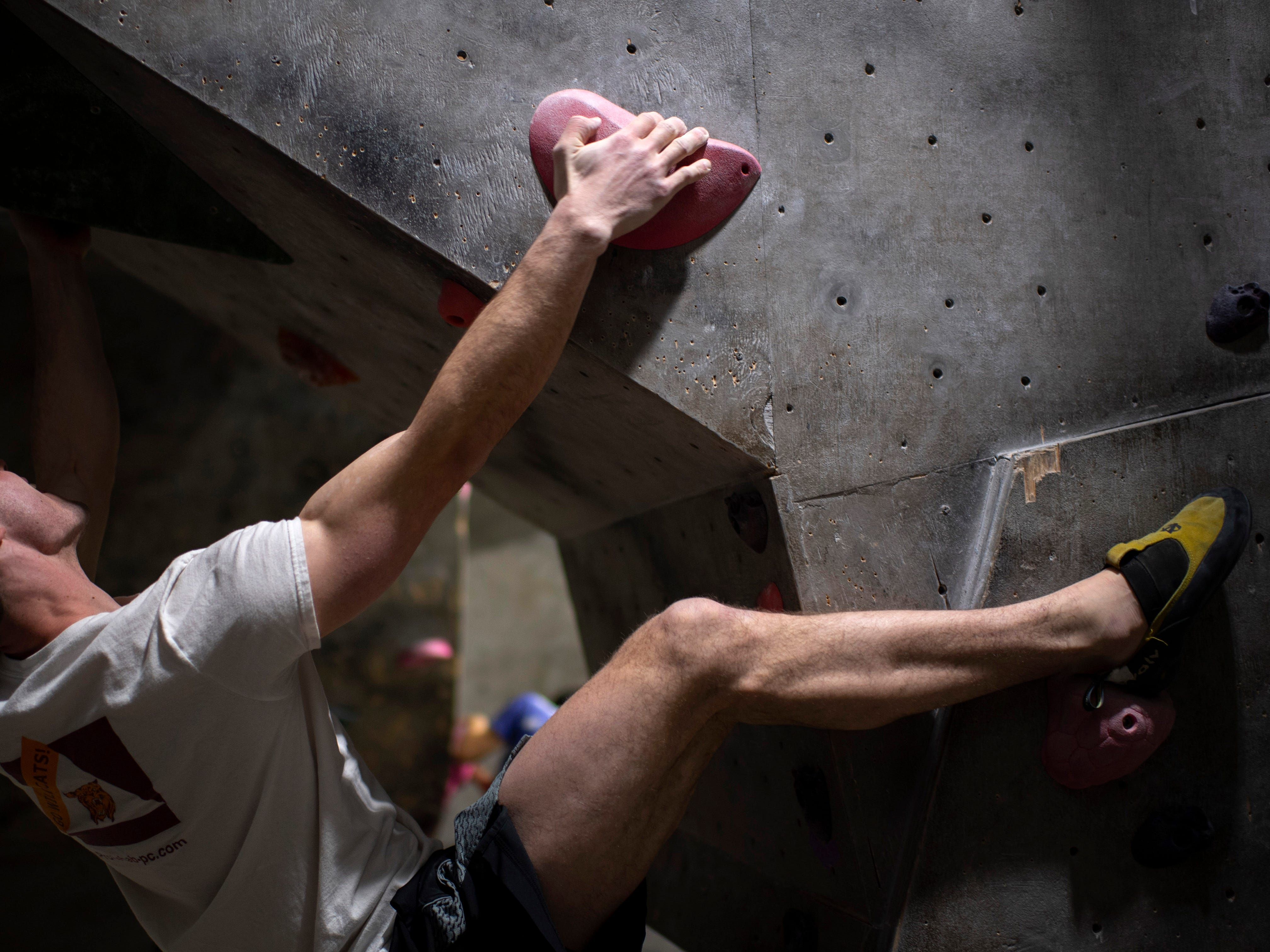 Leo Scheller climbs through a challenging bouldering obstacle at Vertical eXcape at 1315 N. Royal Avenue in Evansville Friday evening.