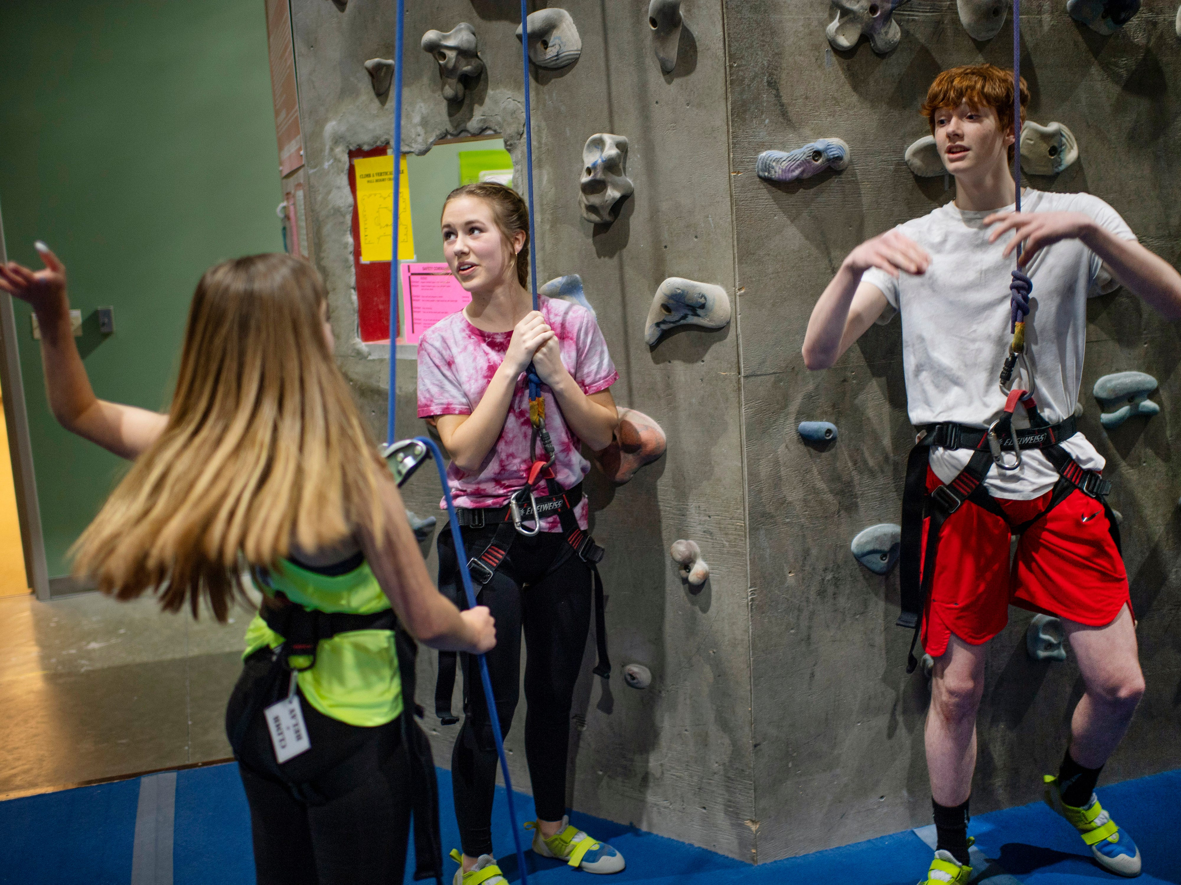 Orientation for the top-roping discipline has, from left, Ashton Zehner, 15, Ella Hubbard, 15, and Ethan Lynn, 15, swapping experiences at Vertical eXcape at 1315 N. Royal Avenue in Evansville Friday evening.