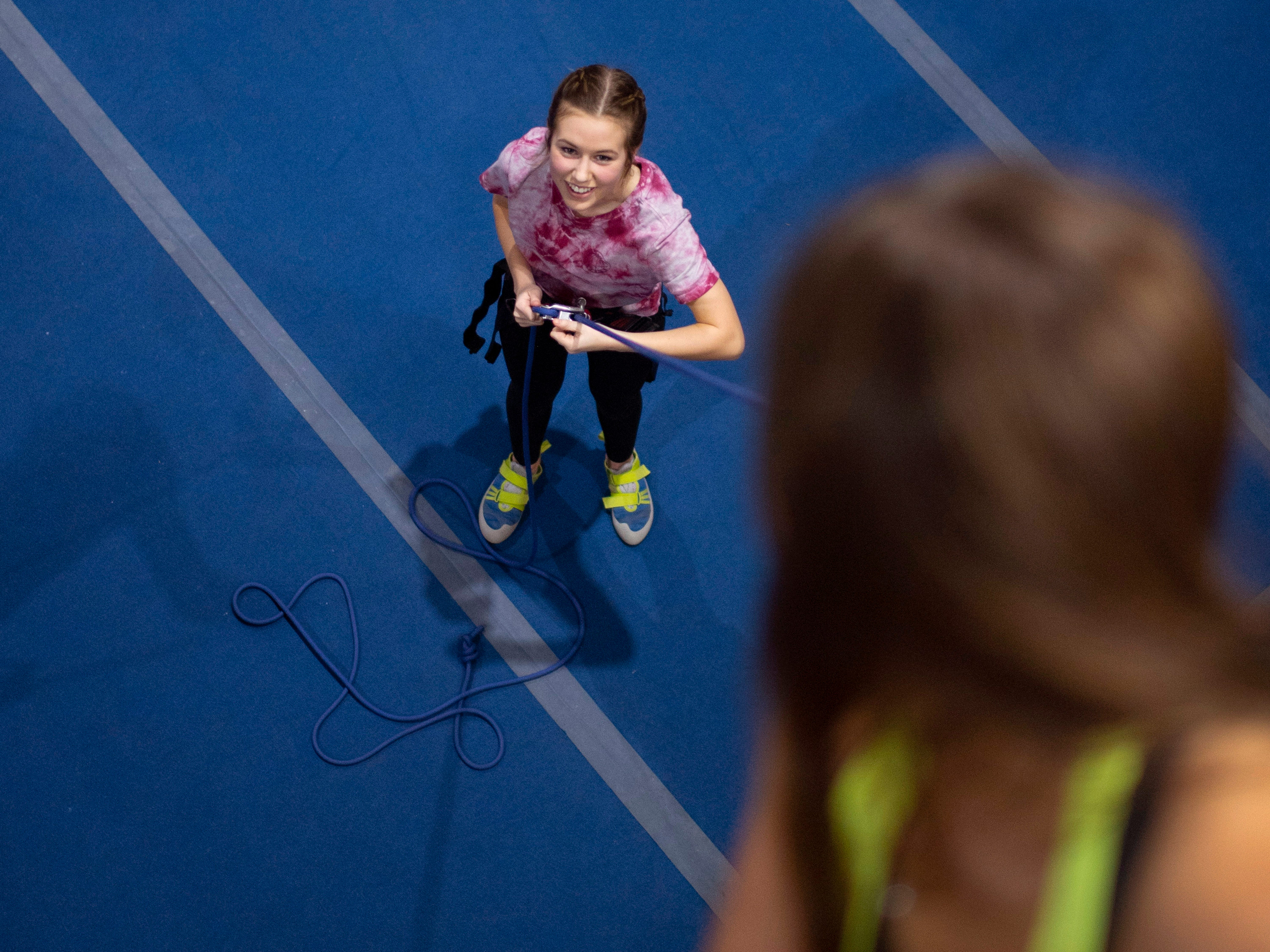 Ella Hubbard, 15, controls the slack of Ashton Zehner's rope during top-roping orientation at Vertical eXcape at 1315 N. Royal Avenue in Evansville Friday evening.