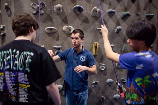 Matt France, center, runs through orientation for Jakeb Beard, 16, a first-timer, left, and Kaleo Chase, 17, at Vertical eXcape at 1315 N. Royal Avenue in Evansville Friday evening.