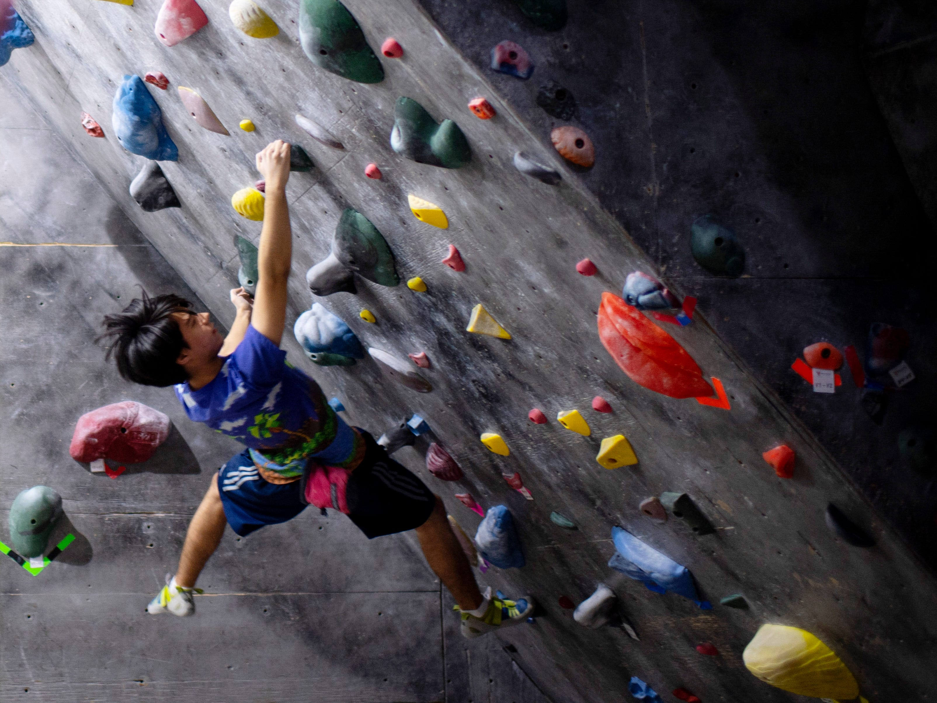 Kaleo Chase, 17, of Newburgh, Ind., traverses through a portion of the bouldering area at Vertical eXcape at 1315 N. Royal Avenue in Evansville Friday evening.