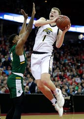 Waupun's Marcus Domask (right) looks to put up a shot against Martin Luther's Xzavier Jones during the WIAA Division 3 boys basketball state championship game at the Kohl Center in Madison.
