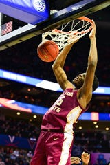 Florida State redshirt sophomore guard Mfiondu Kabengele slams a bucket during the second half of the ACC Tournament Semifinals at the Spectrum Center in Charlotte on Friday.