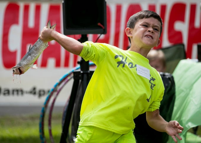 Nolan MacNeil of Cape Coral throws in the Fingerling Mullet Division for ages 6-10 at the 28th Annual Mullet Toss Championship in Matlacha on Saturday, March  16, 2019. MacNeil won with a throw of 71 feet, 11 inches.