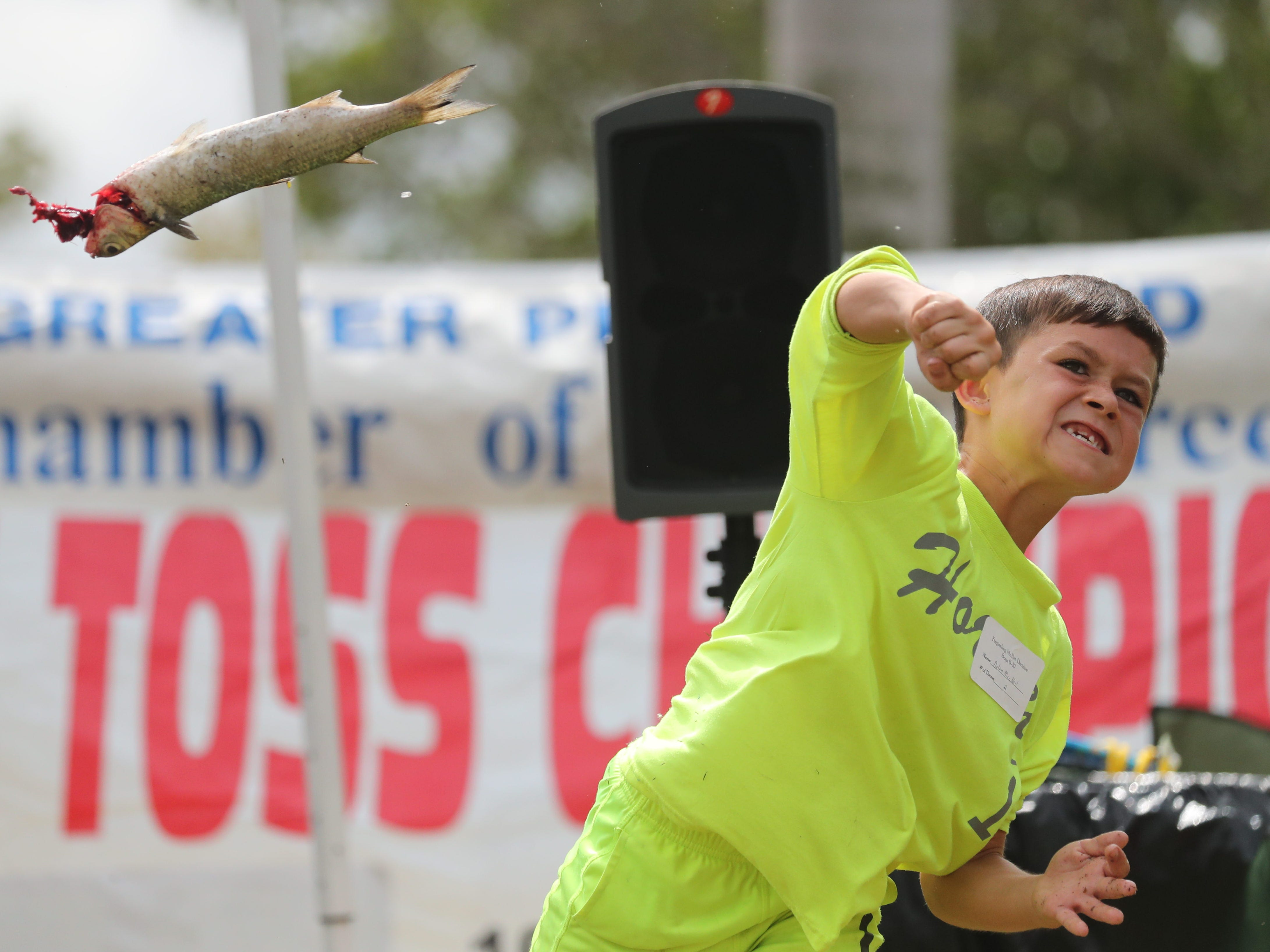 Competitors throw mullet at the 28th Annual Mullet Toss Championship in Matlacha on Saturday, March  16, 2019. Proceeds from the event benefit charities, organizations and individuals around the greater Pine Island area.