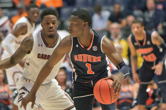 Auburn Tigers guard Jared Harper (1) controls the ball against South Carolina Gamecocks guard Tre Campbell (4) during the second half of game eight in the SEC conference tournament at Bridgestone Arena. Auburn won 73-64.