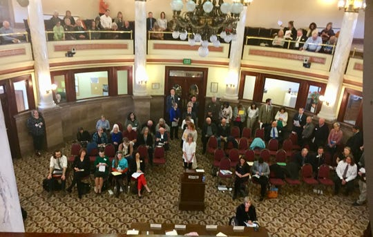 People line up to testify Saturday at the Medicaid expansion hearing in Helena.