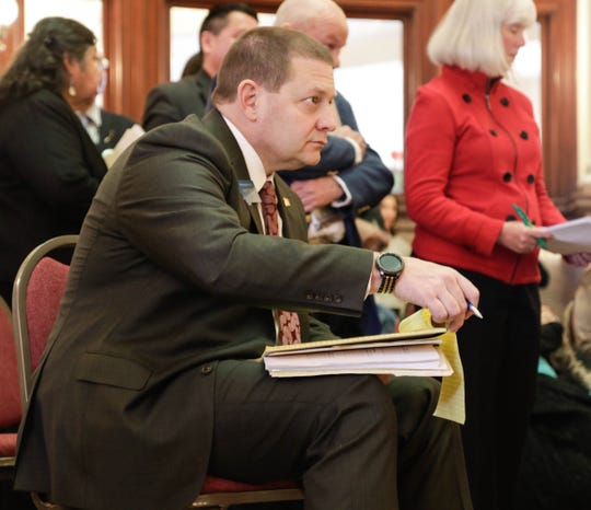 Rep. Ed Buttrey, R-Great Falls, listens March 16 opponents of his bill that would extend Medicaid expansion.