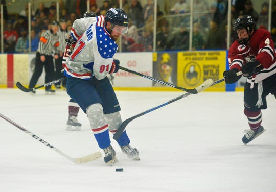 Former Great Falls American forward and captain Lindros Beard navigates the Bozeman defense during a game at the IcePlex last season.