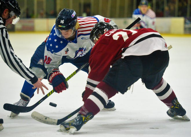Great Falls Americans' Jack Olson faces off against Bozeman Icedogs' Dominic Canic during Friday night's hockey game.
