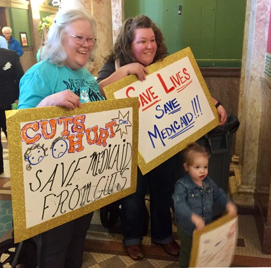 From left, Dena, Jenifer and Parker, 2, Gursky of Helena came to the rally for Medicaid expansion on Saturday at the Capitol and pose for a group picture prior to a rally. Jenifer Gursky said she is not on Medicaid, but came in a show of support.