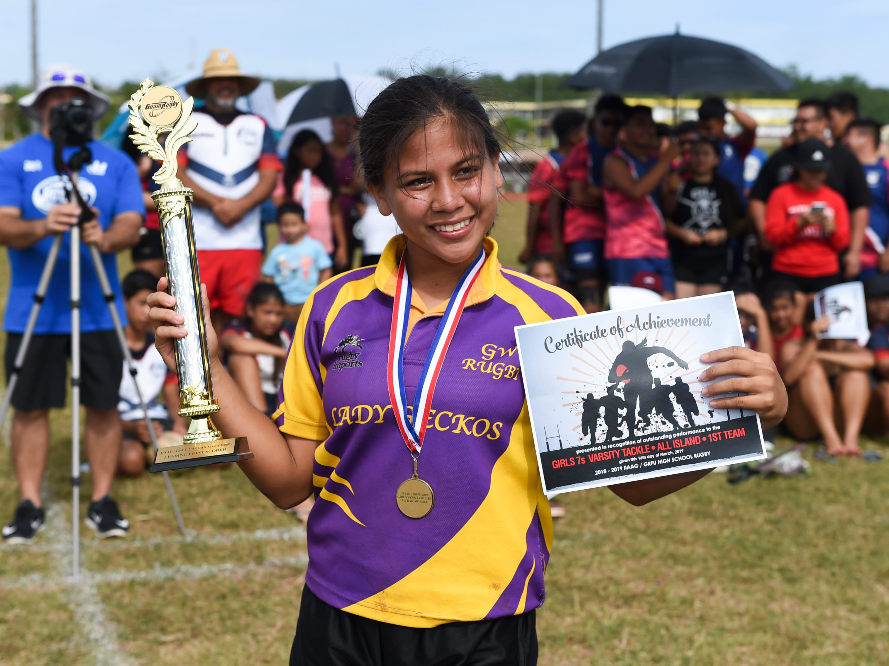 George Washington player Aveah Garrido receives the 2018-2019 IIAAG/GRFU Girls Rugby Top Point Scorer award with 158 points, at the George Washington High School Field, March 16, 2019.