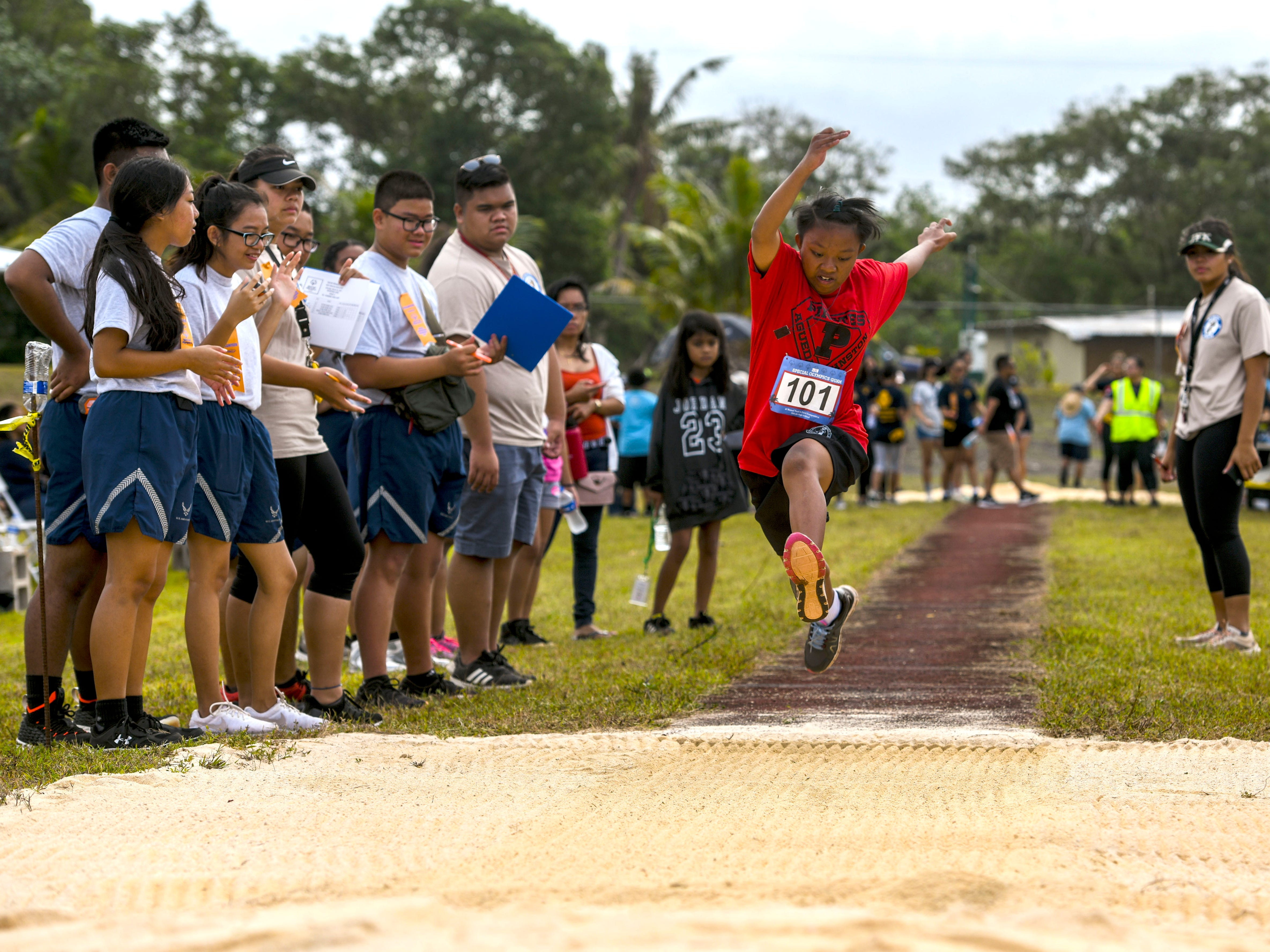 Special Olympian Angel Obra (101) takes flight on her second long jump attempt during the 43rd Special Olympics Guam Track & Field competition at Okkodo High School in Dededo on Saturday, March 16, 2019.