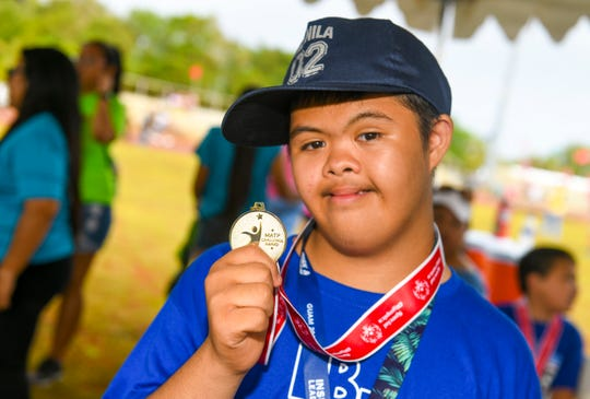 Tamuning Elementary School student, Jabez Rayo, displays a gold medal he was awarded for his participation in a 50-meter during the 43rd Special Olympics Guam Track & Field competition at Okkodo High School in Dededo on Saturday, March 16, 2019.