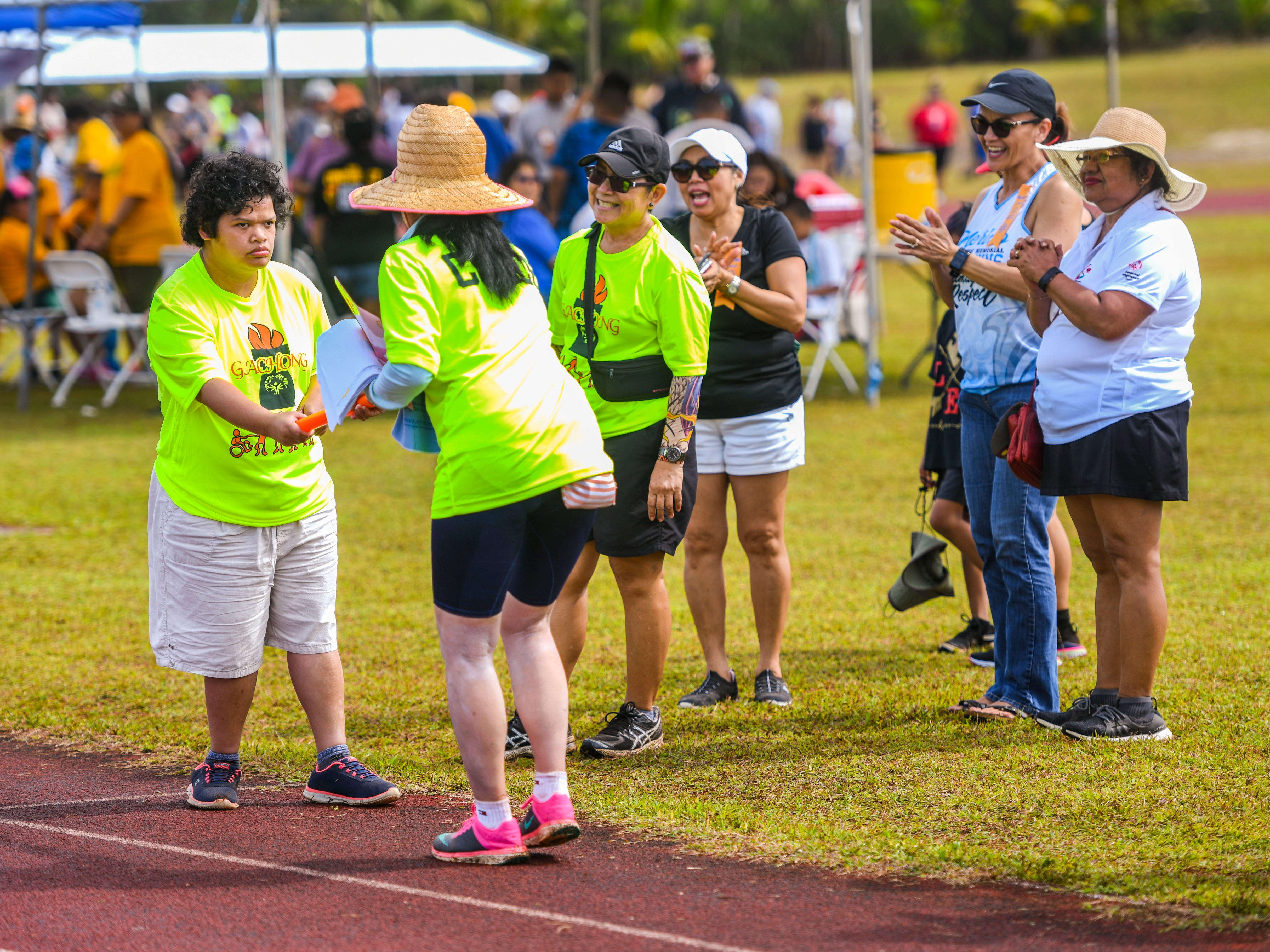 Spectators and volunteers cheer on Special Olympian Amy Vegafria during her participation at the 43rd Special Olympics Guam Track & Field competition at Okkodo High School in Dededo on Saturday, March 16, 2019.