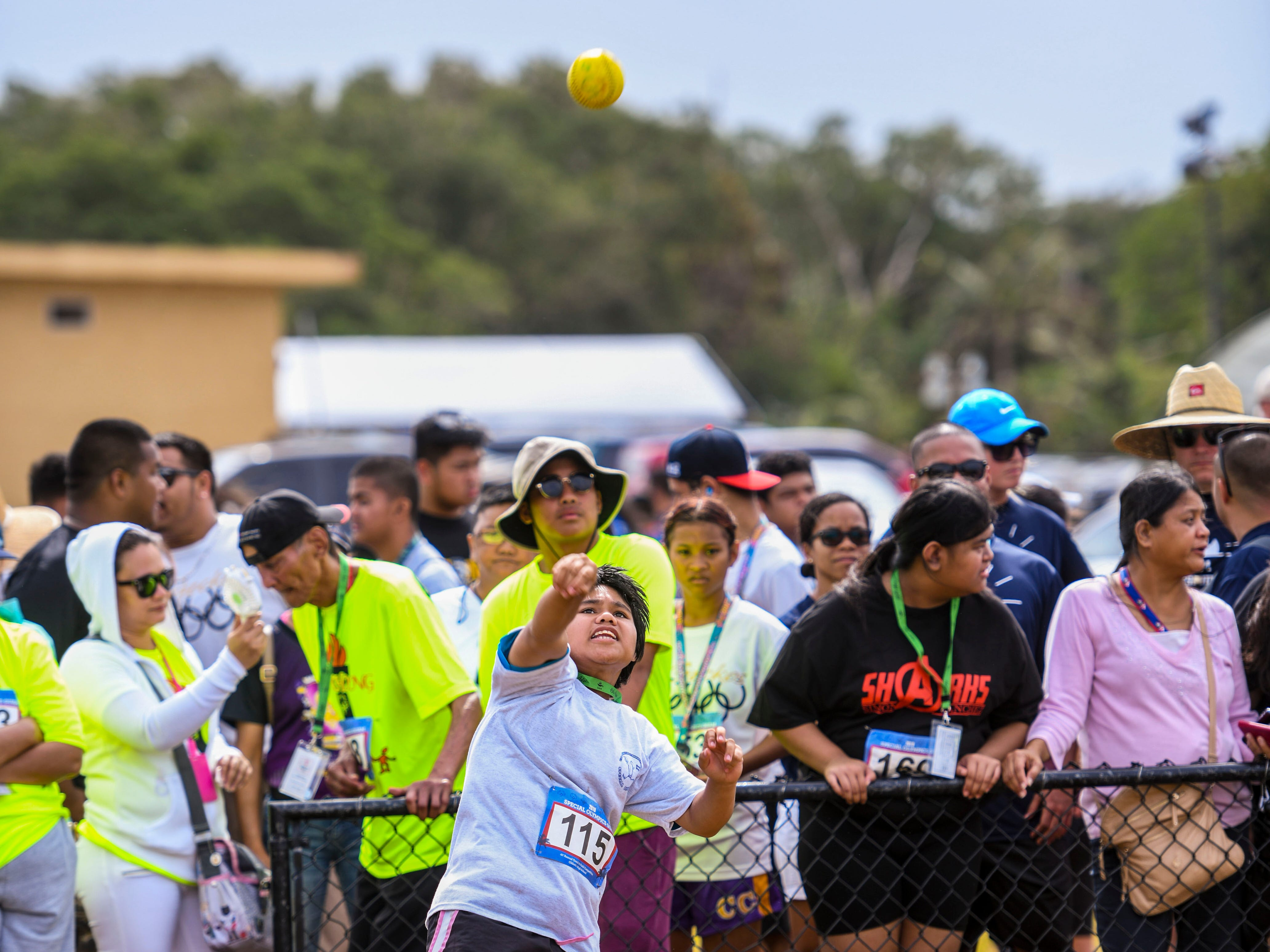 Special Olympian Cristine Alfonso (115) sends a ball skyward during her participation in the softball throw event during the 43rd Special Olympics Guam Track & Field competition at Okkodo High School in Dededo on Saturday, March 16, 2019.