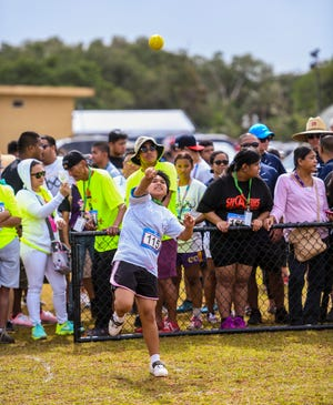 Special Olympian Cristine Alfonso sends a ball skyward during the 43rd Special Olympics Guam Track and Field Event in this March 16, 2019, file photo. This year's event is scheduled for March 14.