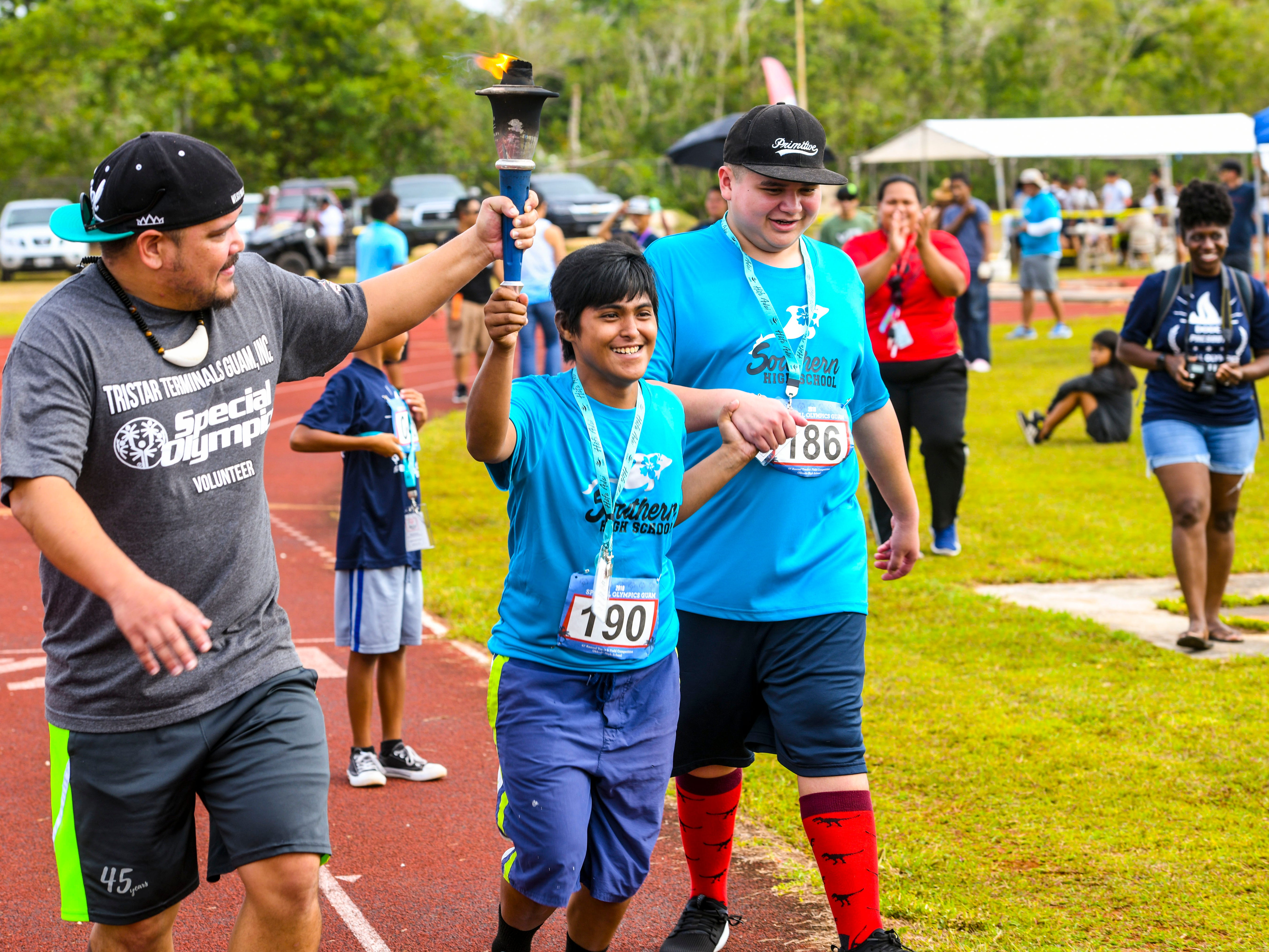Special Olympian Courtney Fernandez participates in the torch relay during the 43rd Special Olympics Guam Track & Field competition at Okkodo High School in Dededo on Saturday, March 16, 2019.